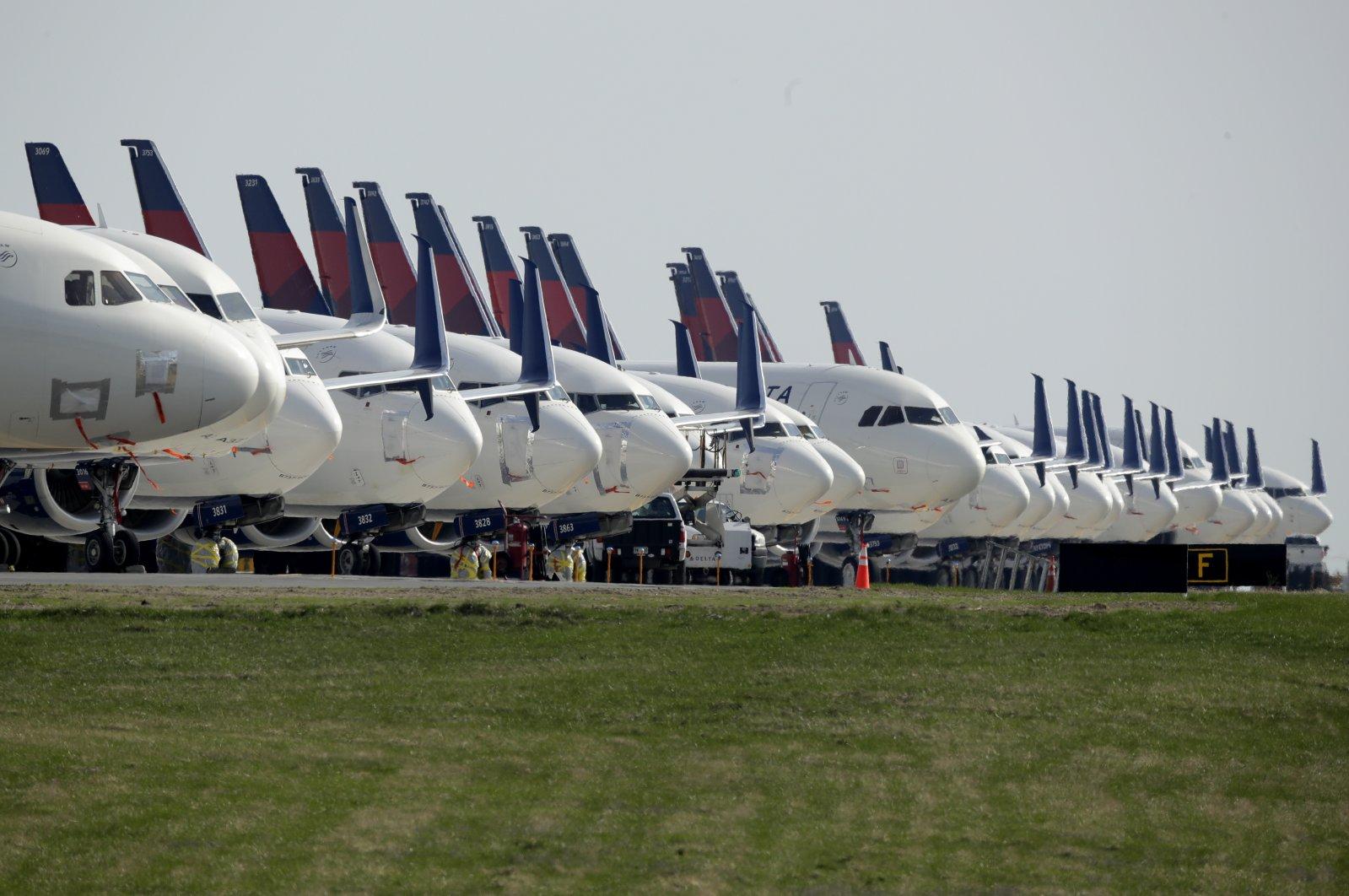 Several dozen mothballed Delta Air Lines jets are parked at Kansas City International Airport in Kansas City, Mo., April 1, 2020. (AP Photo)