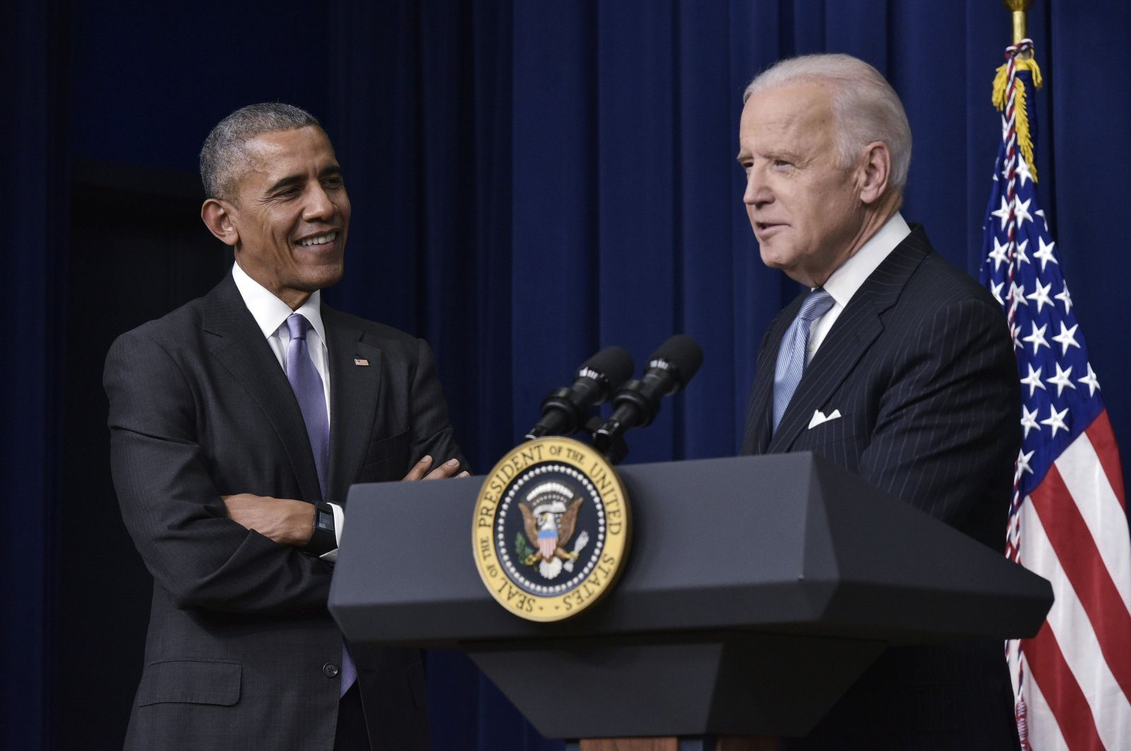 U.S. Vice President Joe Biden (R) speaks, watched by former President Barack Obama, during the signing ceremony for the 21st Century Cures Act in the South Court Auditorium, next to the White House, Washington, D.C., Dec. 13, 2016. (AFP Photo)