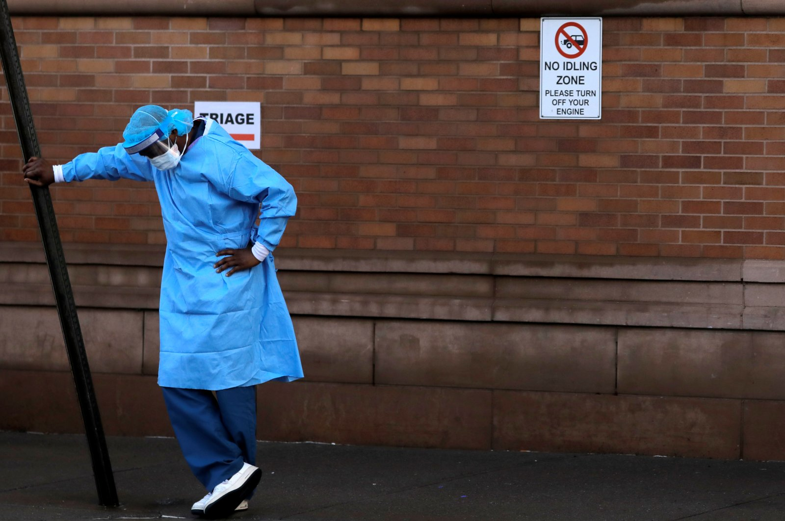A healthcare worker takes a break outside the emergency center at Maimonides Medical Center during the outbreak of COVID-19 in the Brooklyn borough of New York, April 13, 2020. (Reuters Photo)