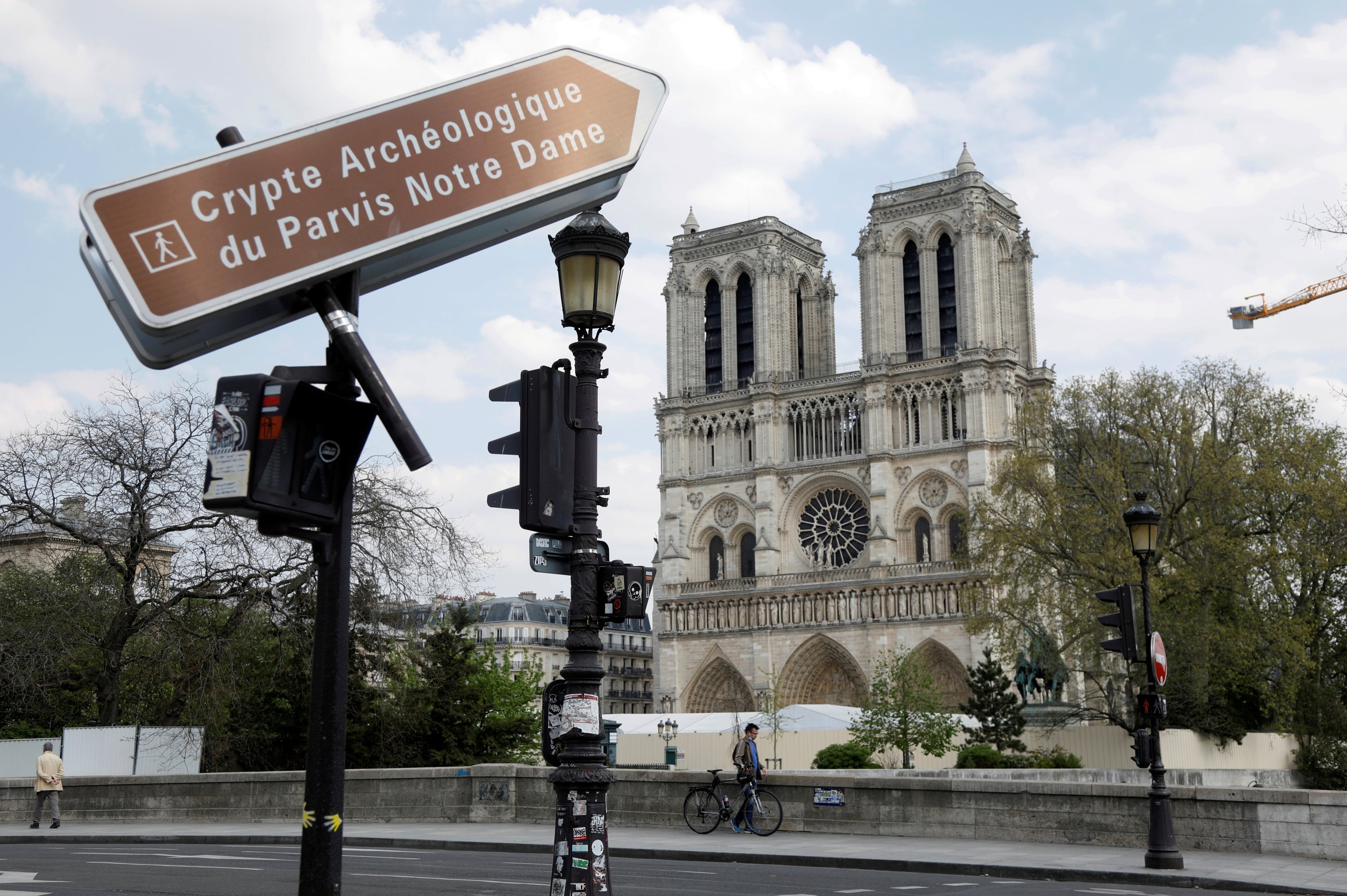 A view shows the Notre-Dame de Paris Cathedral, which was damaged in a devastating fire one year ago, as the coronavirus disease (COVID-19) lockdown slows down its restoration in Paris, France, April 11, 2020.(REUTERS)