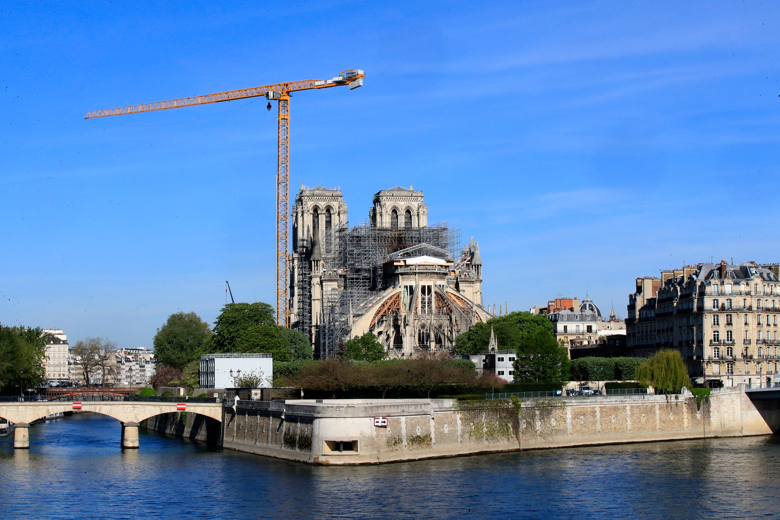 A crane stands by Notre Dame Cathedral Wednesday, April 15, 2020 in Paris. (AP Photo)