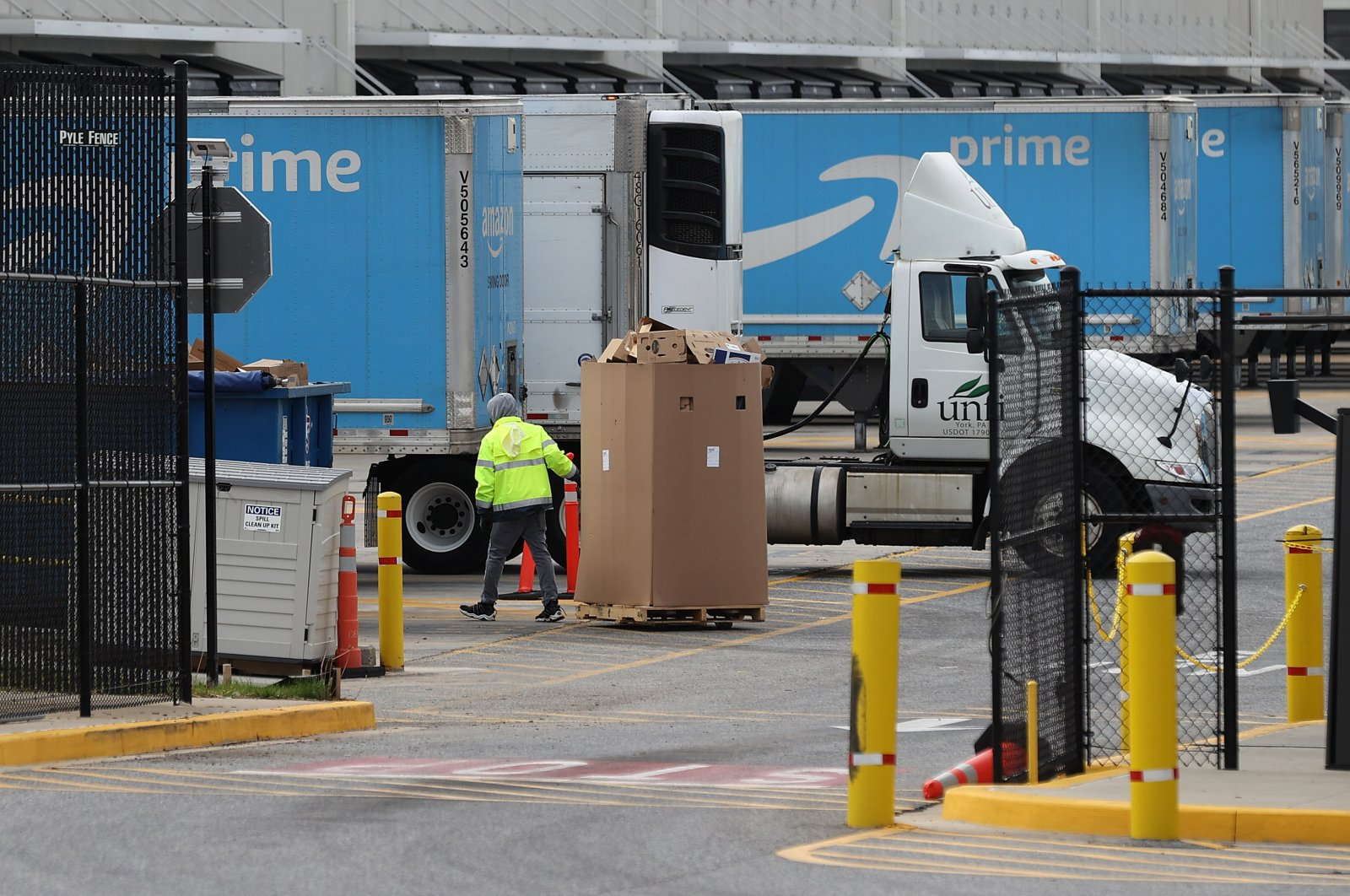 A worker moves boxes at the 1.2 million-square-foot BWI2 Amazon Fulfillment Center employing about 2500 workers in the Chesapeake Commerce Center April 14, 2020 in Baltimore, Maryland. (AFP Photo)