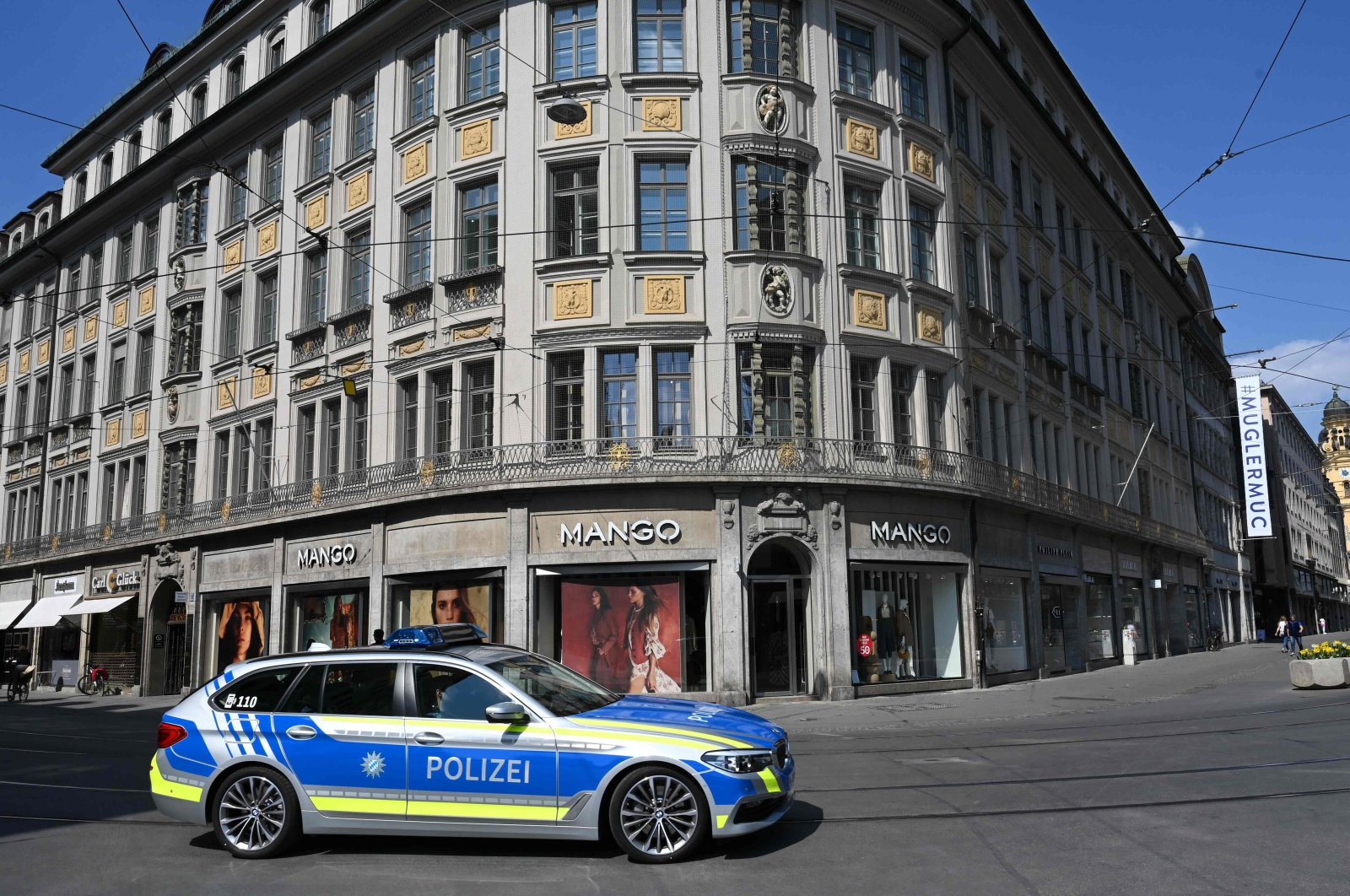 A police car patrols empty streets in the center of Munich as public life in Bavaria has been limited due to the spread of the coronavirus, southern Germany, April 9, 2020. (AFP Photo)