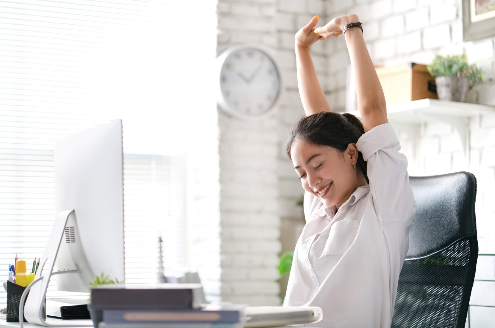 Doing stretches regularly at your desk can help ease the stiffness in your muscles. (iStock Photo)