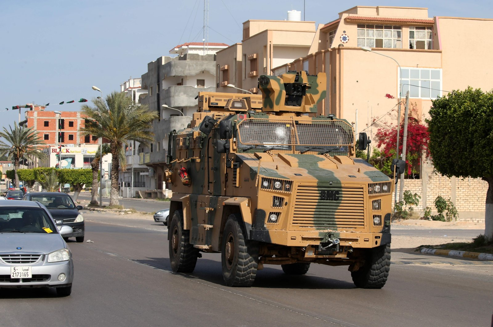An armoured personnel vehicle drives down a street in the Libyan coastal city of Sorman on April 13, 2020, after Libya's unity government seized two coastal cities between Tripoli and the Tunisian border from troops backing putschist Gen. Khalifa Haftar. (AFP Photo)
