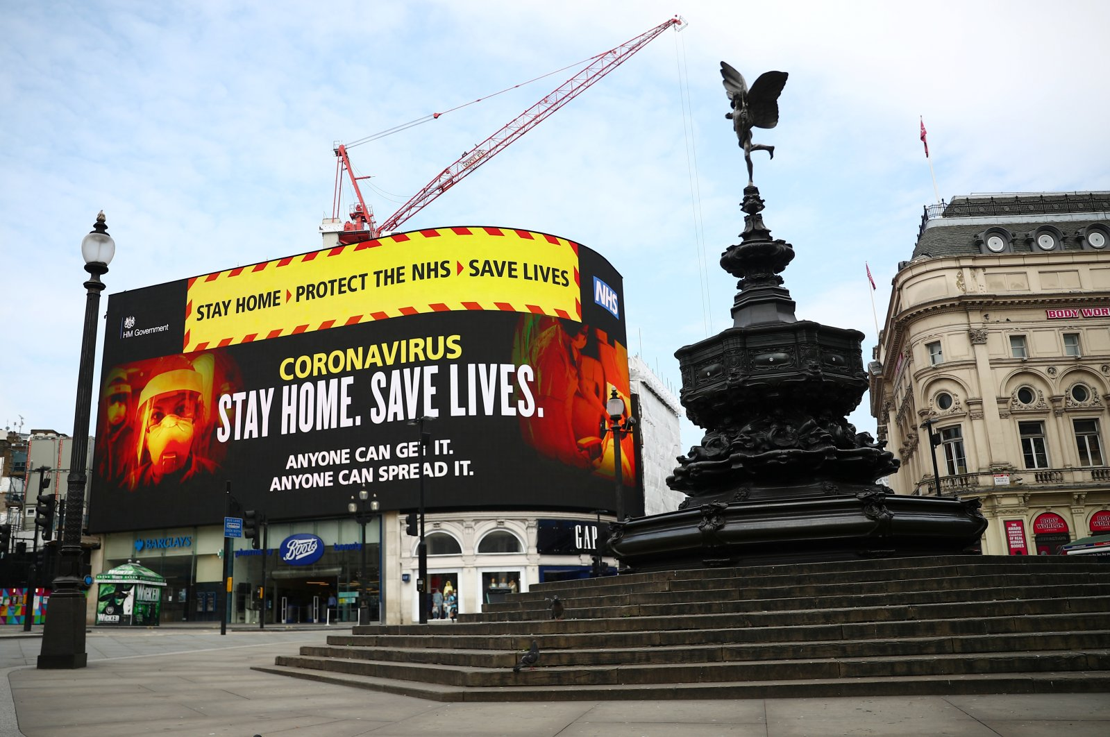 A UK government public health campaign is displayed in Piccadilly Circus, as the spread of the coronavirus disease (COVID-19) continues, London, Britain, April 8, 2020. (Reuters Photo)