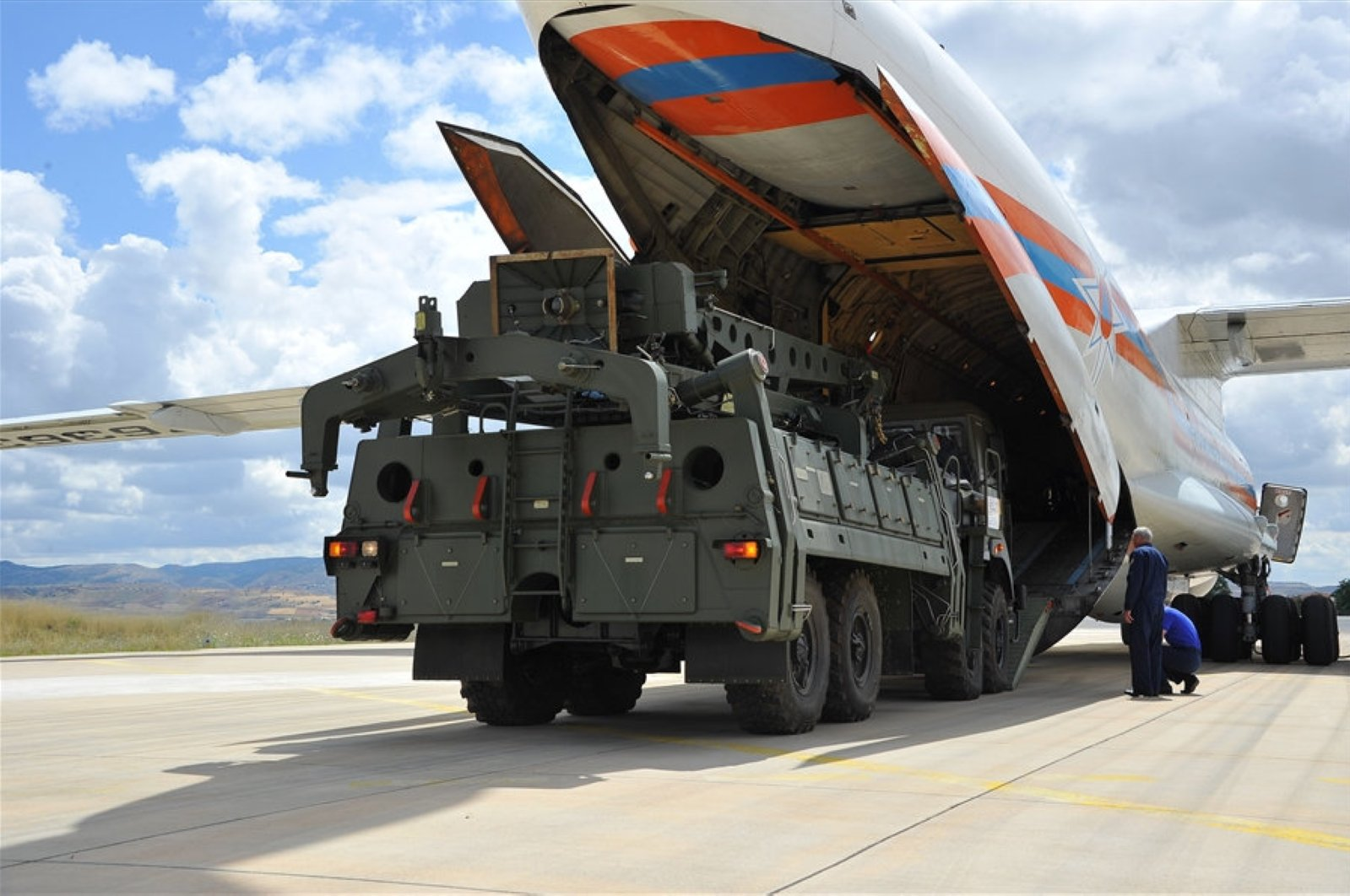 Military vehicles and equipment, parts of the S-400 air defense systems, are unloaded from a Russian transport aircraft, at the Murted Military Airport, Ankara, Turkey, July 12, 2019. (Turkish Defense Ministry via DHA)
