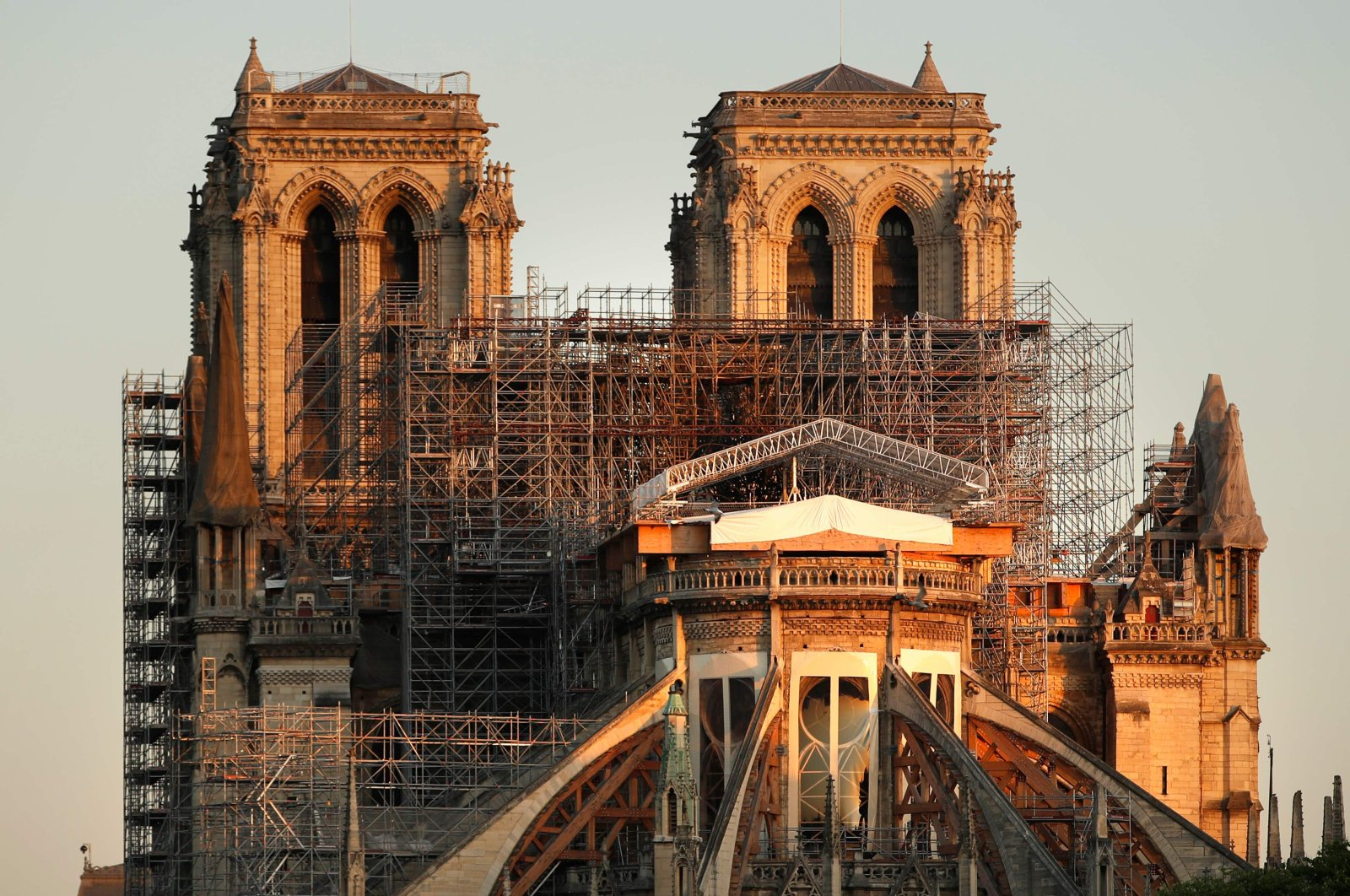 This picture taken on April 14, 2020 shows the Paris' Cathedral Notre Dame at the sunrise on the eve of the first anniversary of the violent fire who destroyed a large part of the monument, on the twenty-nineth day of a lockdown in France to stop the spread of the  COVID-19. (AFP Photo)