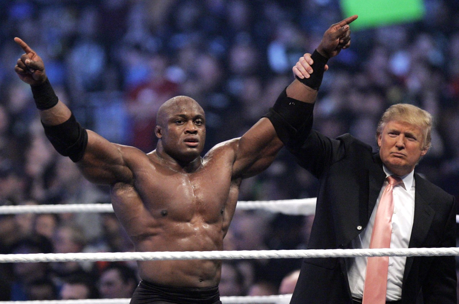 Donald Trump raises the arm of wrestler Bobby Lashley after he defeated Umaga at Wrestlemania 23 at Ford Field, Detroit, April 1, 2007. (AP Photo)