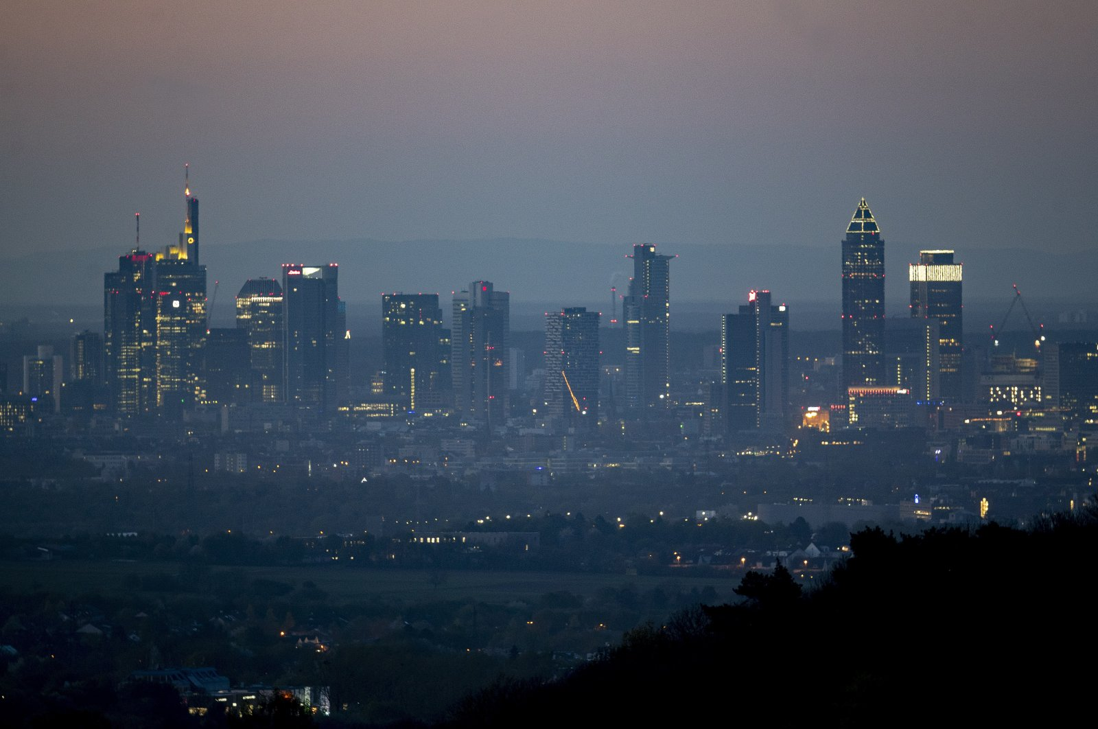 The buildings of the banking district in Frankfurt against an early morning skyline, Germany, April 14, 2020. (AP Photo)
