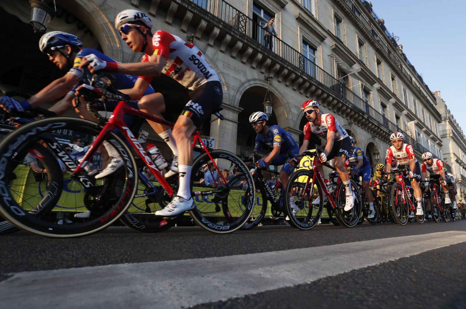 The pack cycles through the streets of Paris during the 21st stage of the Tour de France cycling race in Paris, France, July 28, 2019. (AP Photo)
