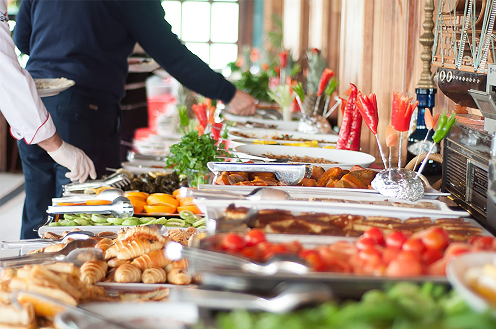 The coronavirus outbreak will change tourists' eating habits, causing them to avoid open buffets. (File Photo)