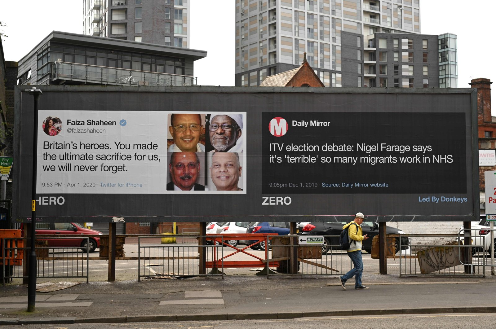 A man passes posters critical of comments made by Brexit Party leader Nigel Farage during the nationwide lockdown to combat the novel coronavirus pandemic in a near-deserted Manchester, England, April 12, 2020. (AFP Photo)