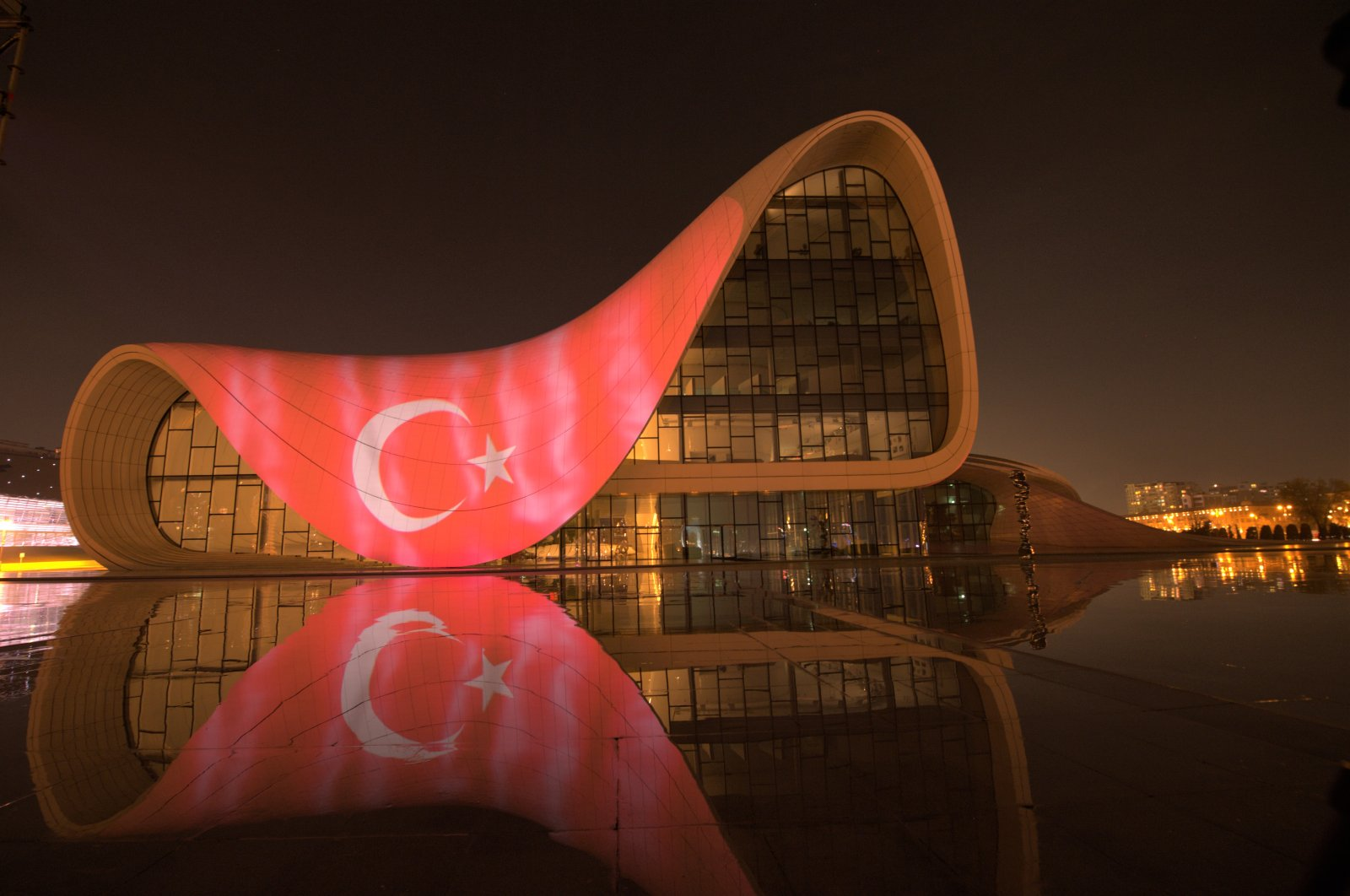 Turkey and Azerbaijan lit up iconic buildings in Ankara and Baku, their respective capitals, with both countries' flags, honoring their cooperation against the COVID-19 outbreak, Saturday, April 11, 2020. (AA)