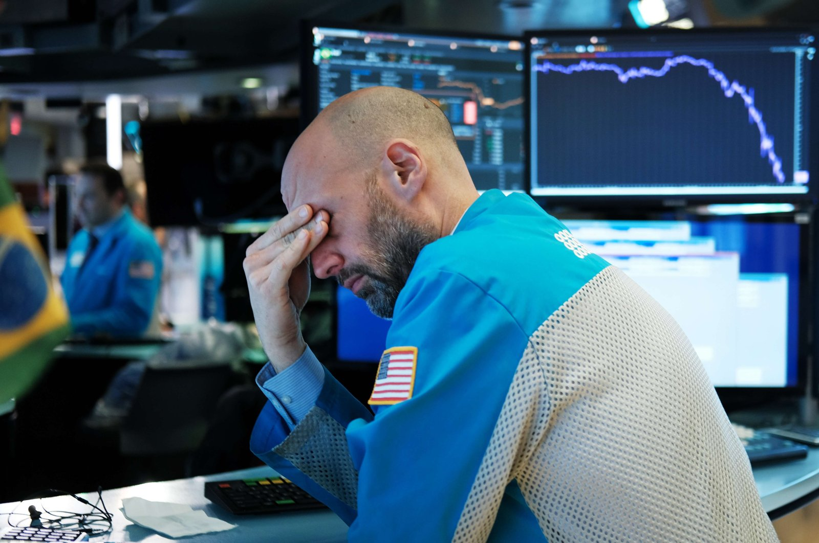 Traders work on the floor of the New York Stock Exchange (NYSE), New York City, March 18, 2020. (AFP)