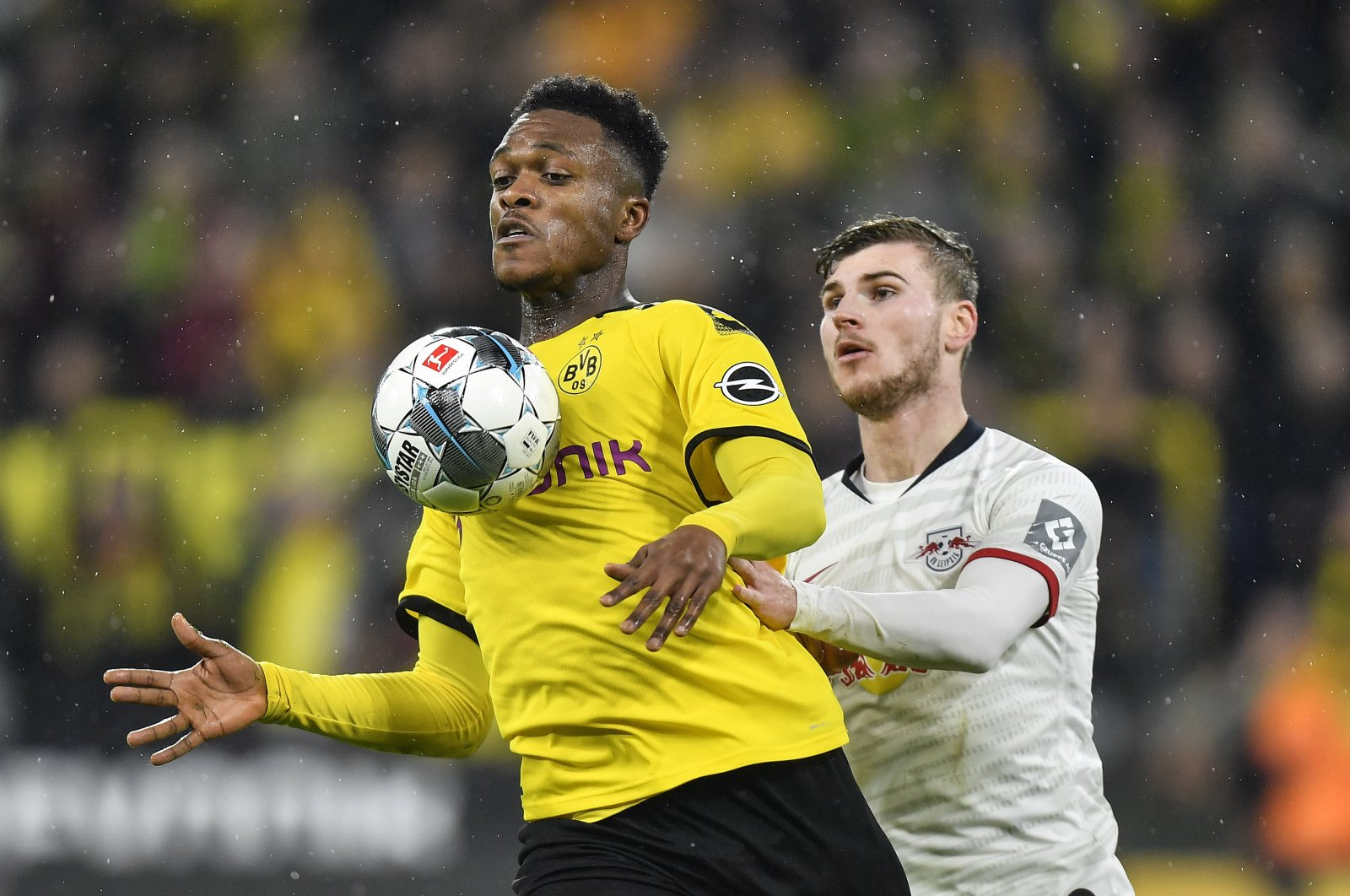 Dortmund's Dan-Axel Zagadou, left, and Leipzig's Timo Werner challenge for the ball during their German Bundesliga match in Dortmund, Germany, Dec. 17, 2019. (AP Photo)