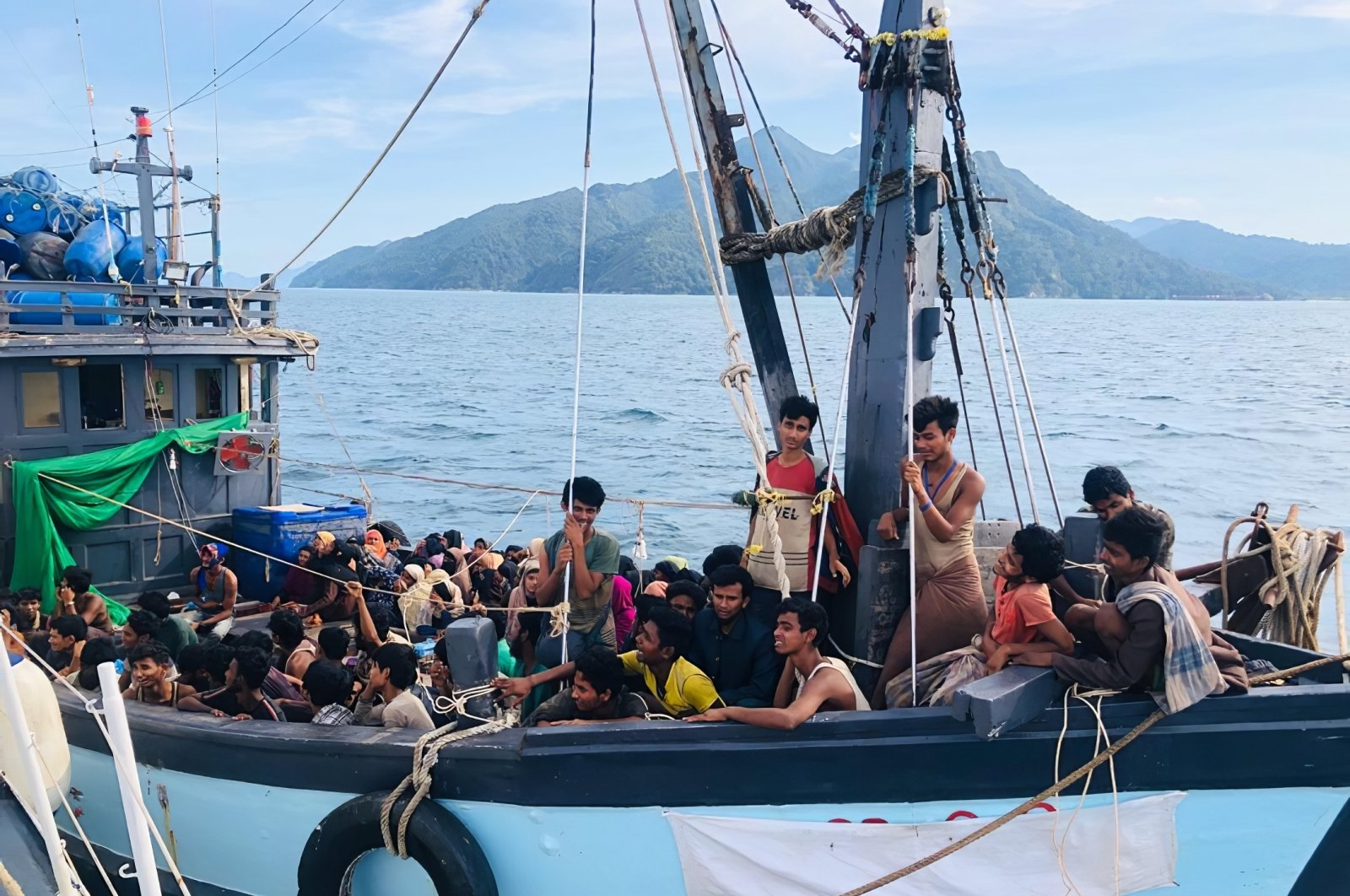 A wooden boat carries suspected Rohingya migrants detained in Malaysian territorial waters off the island of Langkawi, Malaysia, April 5, 2020. (Malaysian Maritime Enforcement Agency via AP)