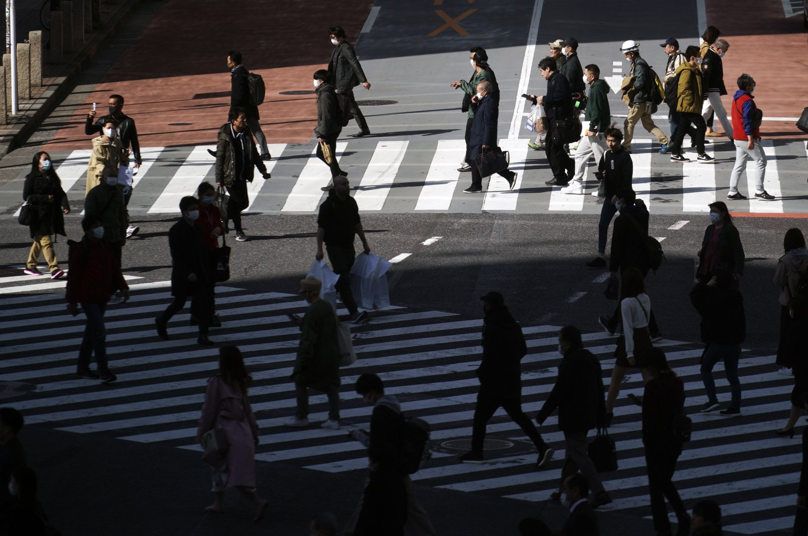 Fewer than usual people at Shibuya Scramble Crossing are seen in Tokyo, Japan, Tuesday, April 14, 2020. (AP Photo)