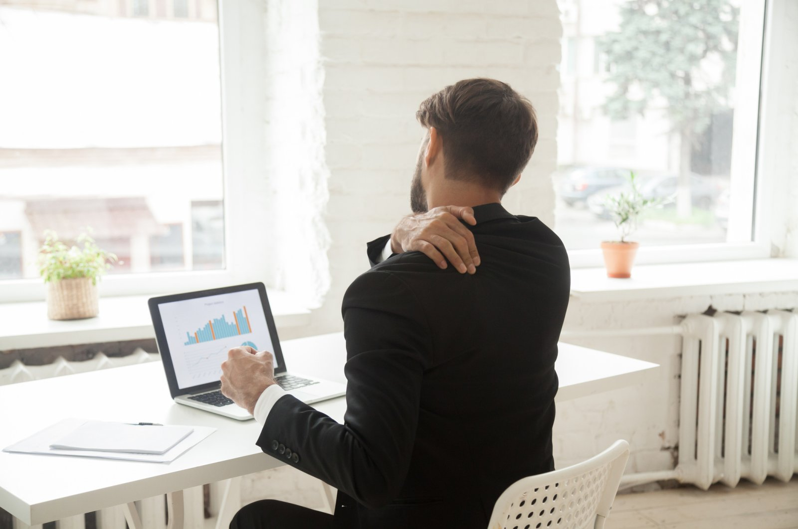 When you are tired after long working hours in front of the computer, little exercises like shoulder rolls can ease your muscles. (iStock Photo)