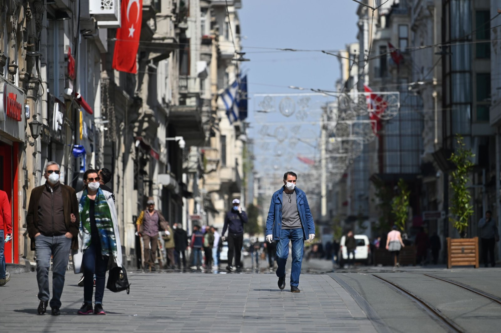 People wear face masks as they walk down İstiklal Avenue in Istanbul, Turkey, April 14, 2020. (AFP Photo)