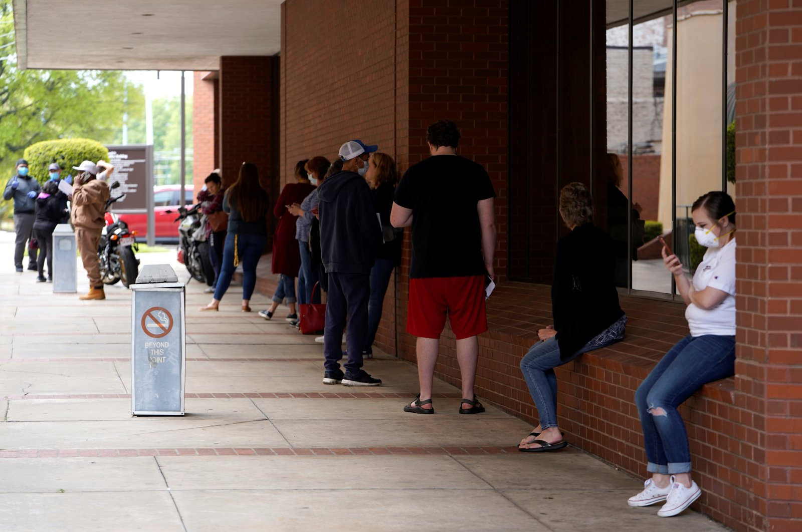 People who lost their jobs wait in line to file for unemployment following an outbreak of the coronavirus, at an Arkansas Workforce Center in Fort Smith, Arkansas, U.S., April 6, 2020. (Reuters Photo)
