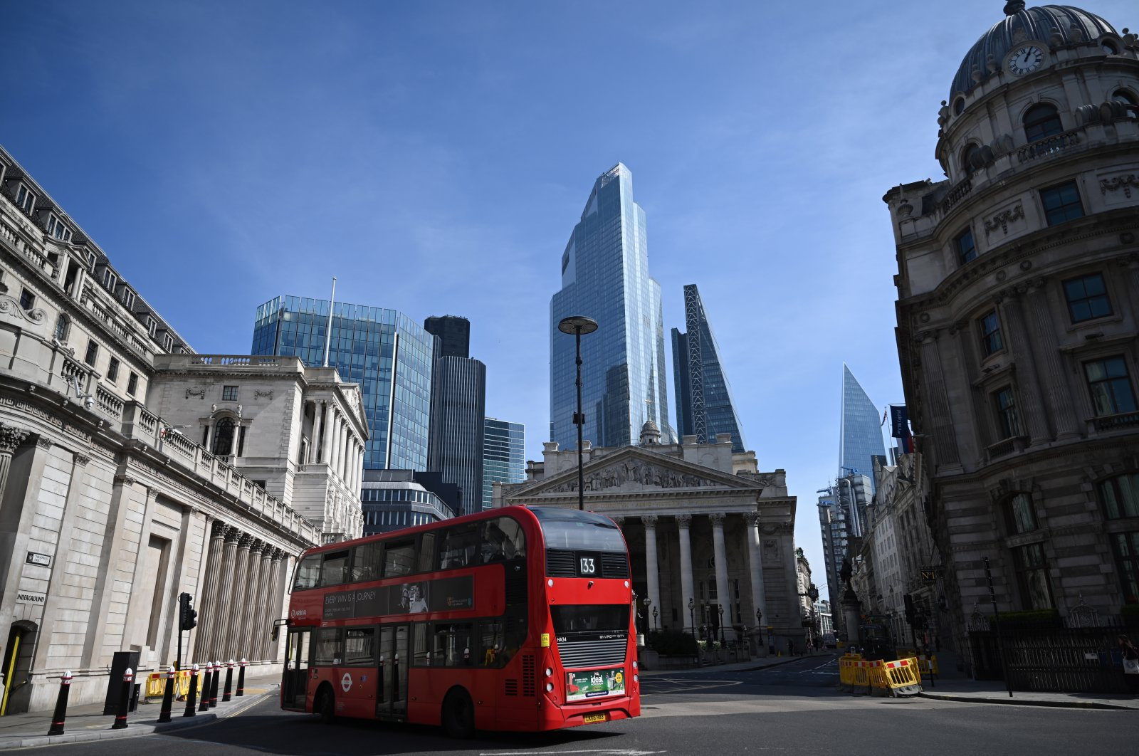 A bus passes the Bank of England in The City of London financial district in London, Britain, April 15, 2020. (EPA Photo)