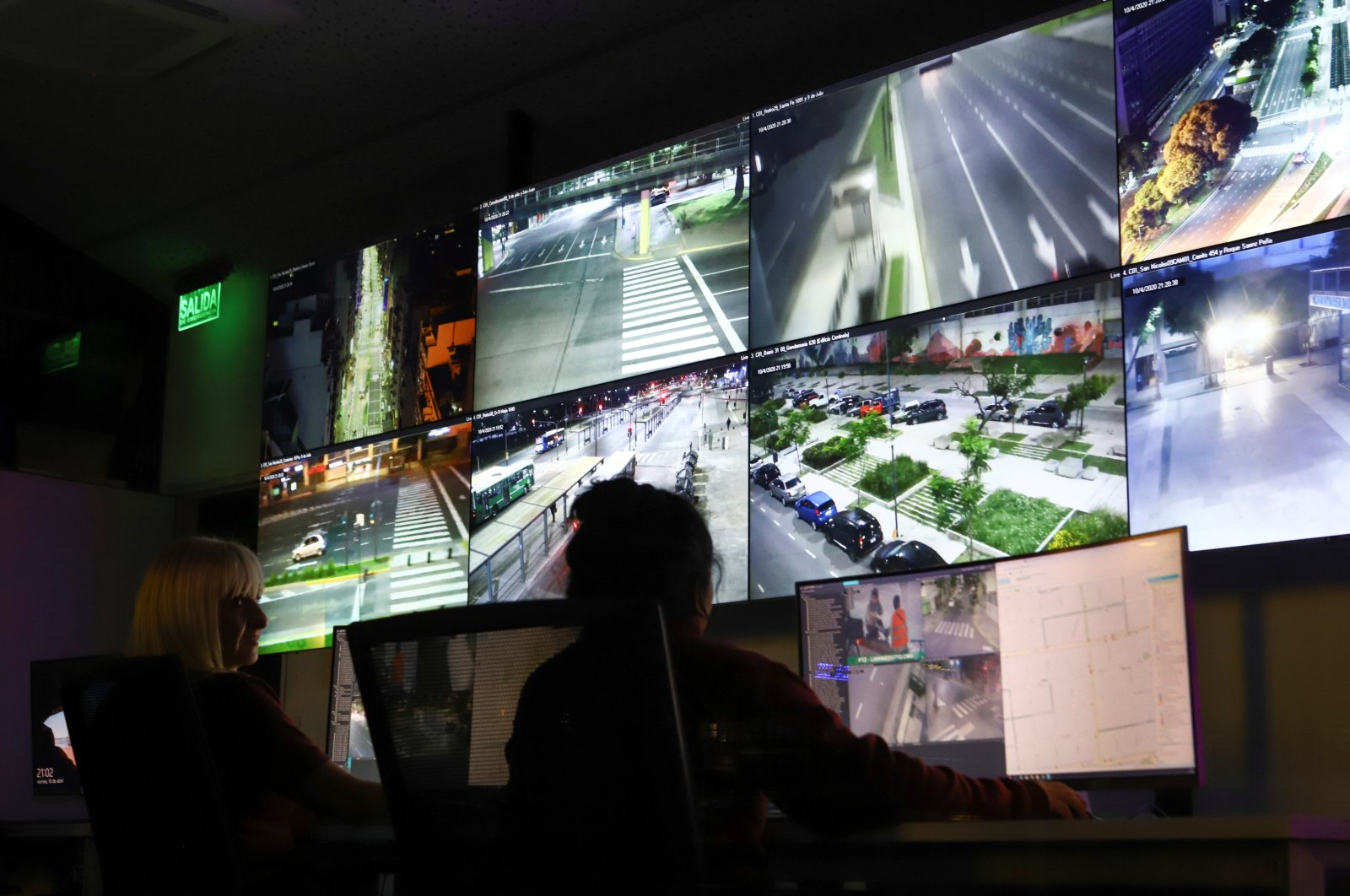 Argentine police officers monitor traffic on the streets from surveillance camera footage, in Buenos Aires, Argentina, April 10, 2020. (Reuters Photo)