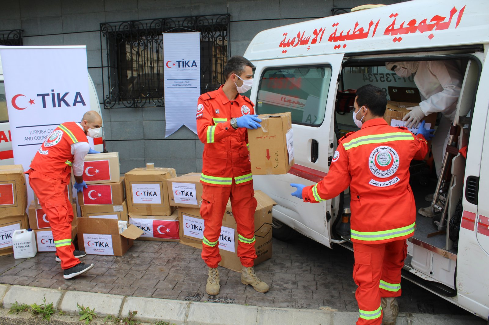 TİKA workers load medical supplies into an ambulance in Lebanon, April 15, 2020. (AA Photo)
