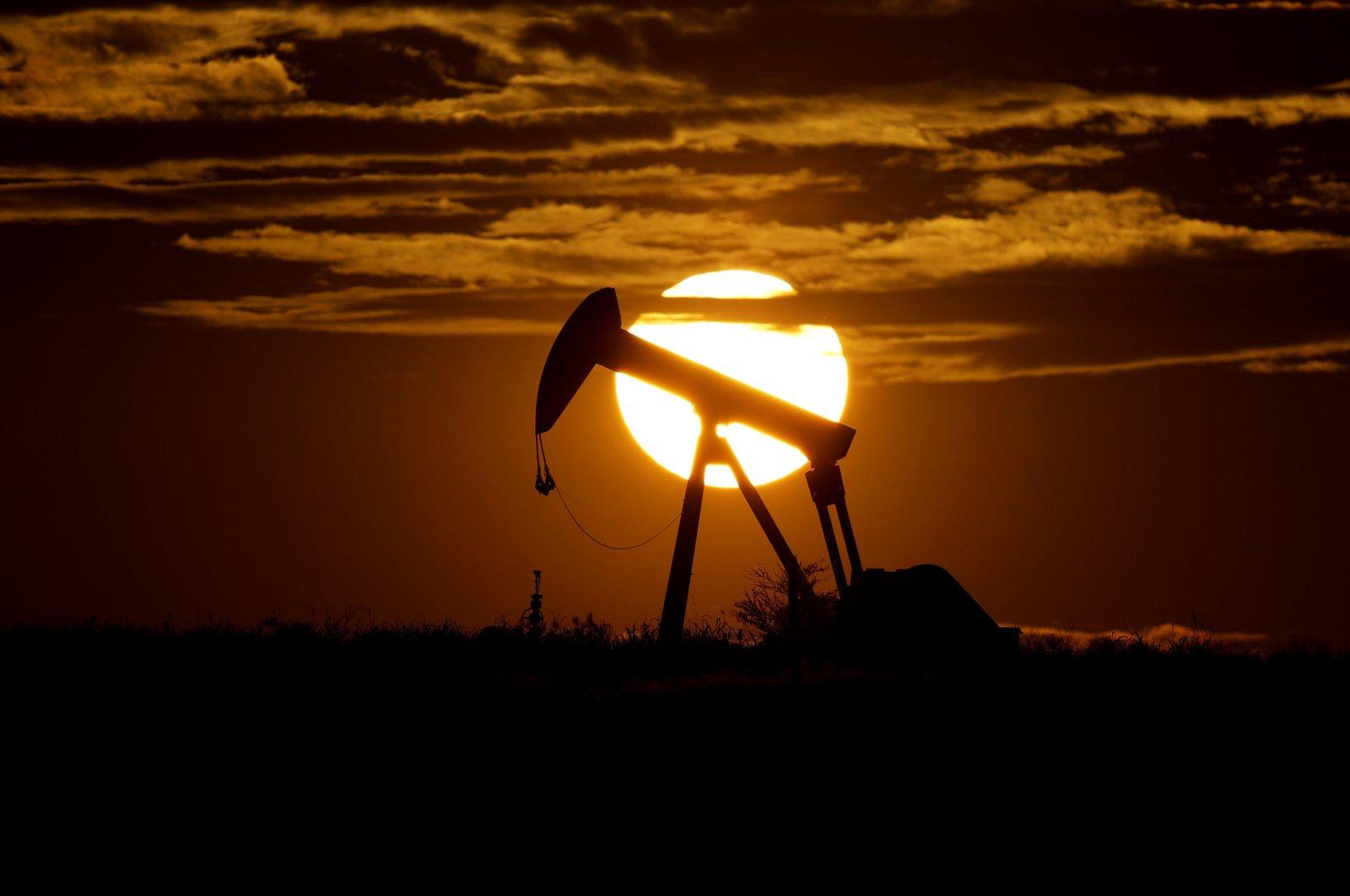 The sun sets behind an idle pump jack near Karnes City, Texas, U.S., April 8, 2020. (AP Photo)