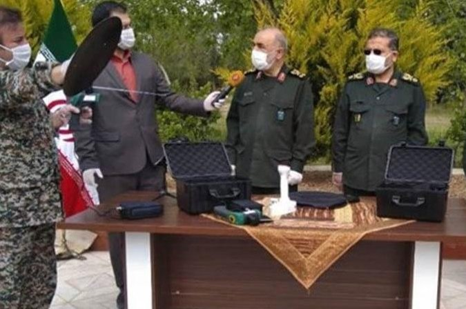 """IRGC officials during a presentation of the so-called """"coronavirus detector,"""" in Tehran, 16 April 2020."""