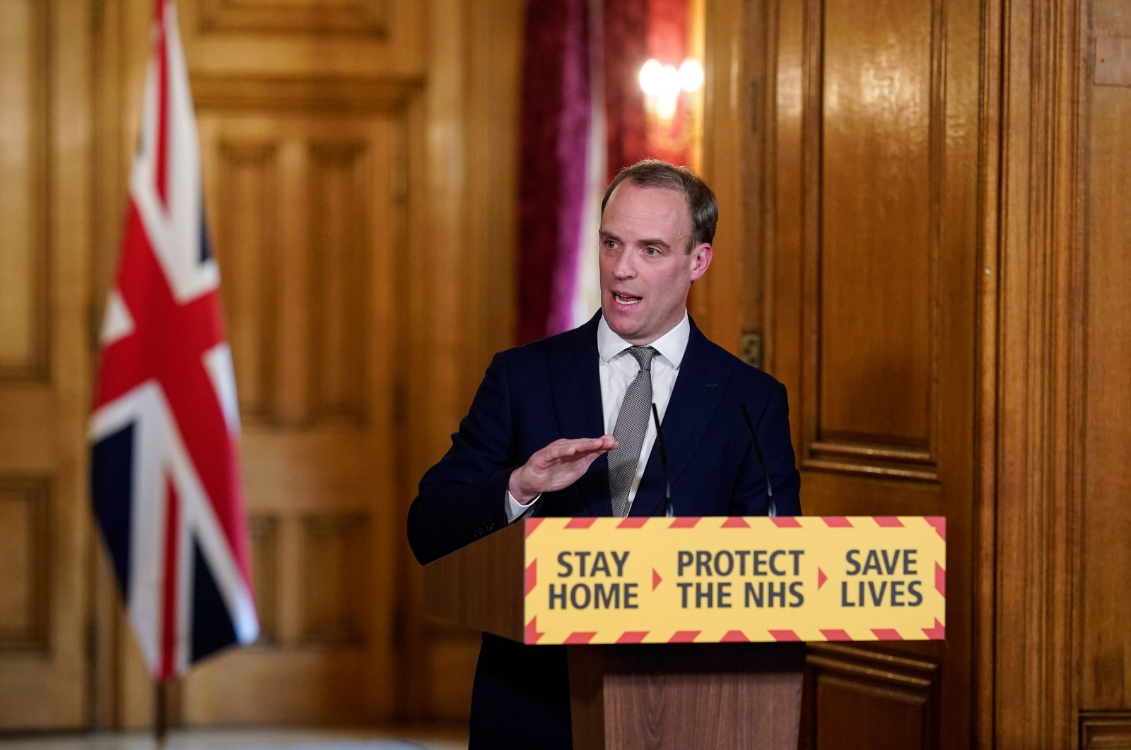 A handout image released by 10 Downing Street, shows Britain's Foreign Secretary Dominic Raab speaking during a remote press conference to update the nation on the COVID-19 pandemic, London, Thursday, April 16, 2020. (AFP Photo)
