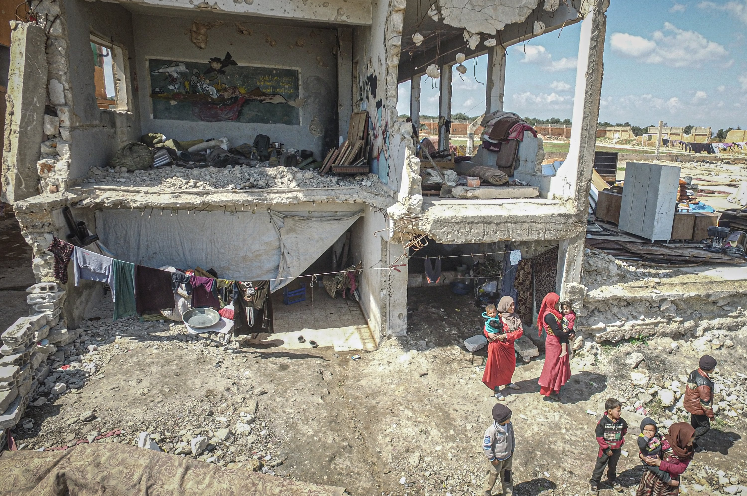 16 displaced Syrian families are living in two heavily damaged schools, located side by side, Idlib, Friday, April 17, 2020. (AA)