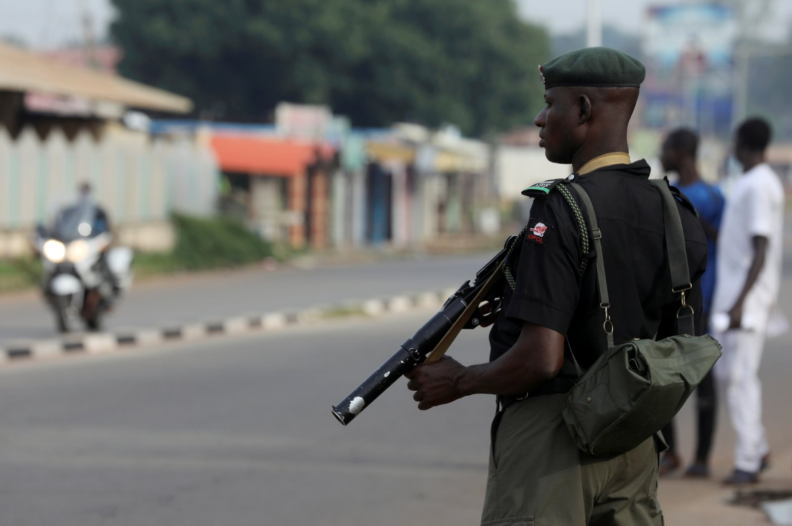 A member of security forces stands guard outside a court in the northern city of Kaduna, Nigeria, Oct. 4, 2018. (Reuters Photo)