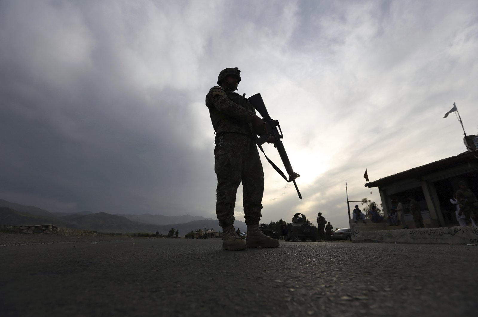 In this Saturday, April 4, 2020 file photo, an Afghan National Army soldier stands guard at a checkpoint on the Jalalabad-Kabul highway, in the Laghman province, east of Kabul, Afghanistan. (AP Photo)