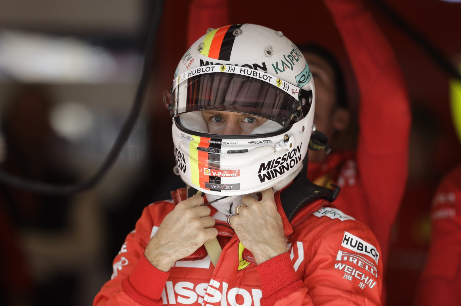 Ferrari driver Sebastian Vettel looks at the results from the second practice session for the F1 U.S. Grand Prix auto race in Austin, Texas, U.S., Nov. 1, 2019. (AP Photo)
