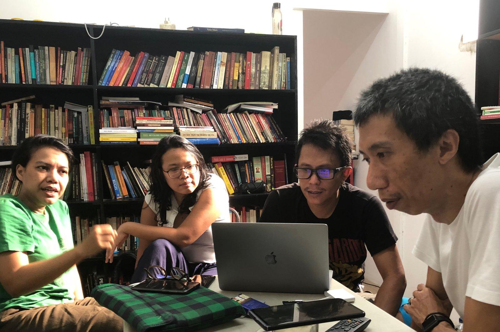 From left to right, Reza Afisina, Ajang Nurul Aini, Mirwan Andan and Iswanto Hartono from the artist collective Ruangrupa prepare the festival digitally. (DPA Photo)