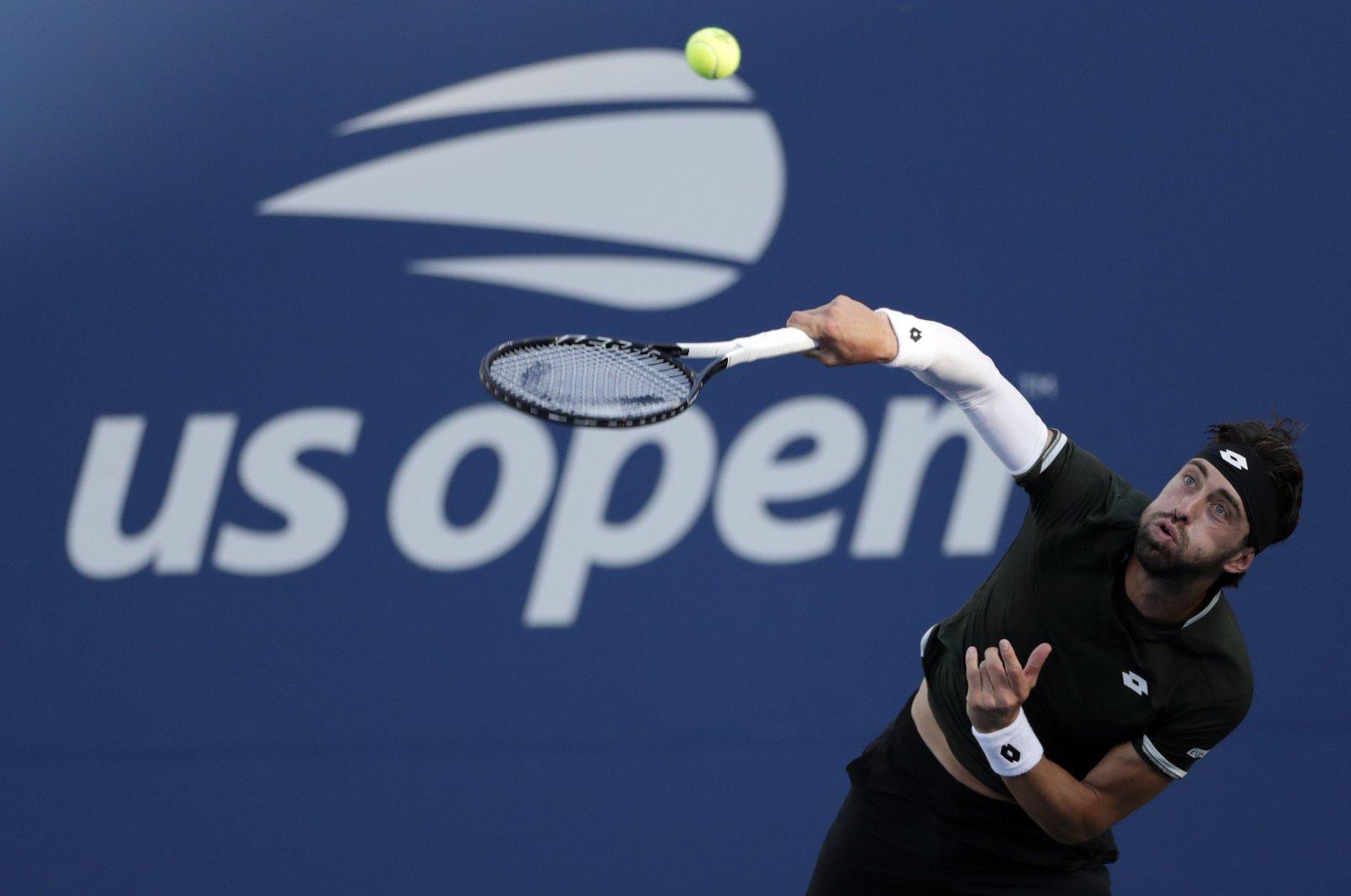 Nikoloz Basilashvili serves to Dominik Koepfer during the third round of the U.S. Open in New York, Aug. 30, 2019. (AP Photo)
