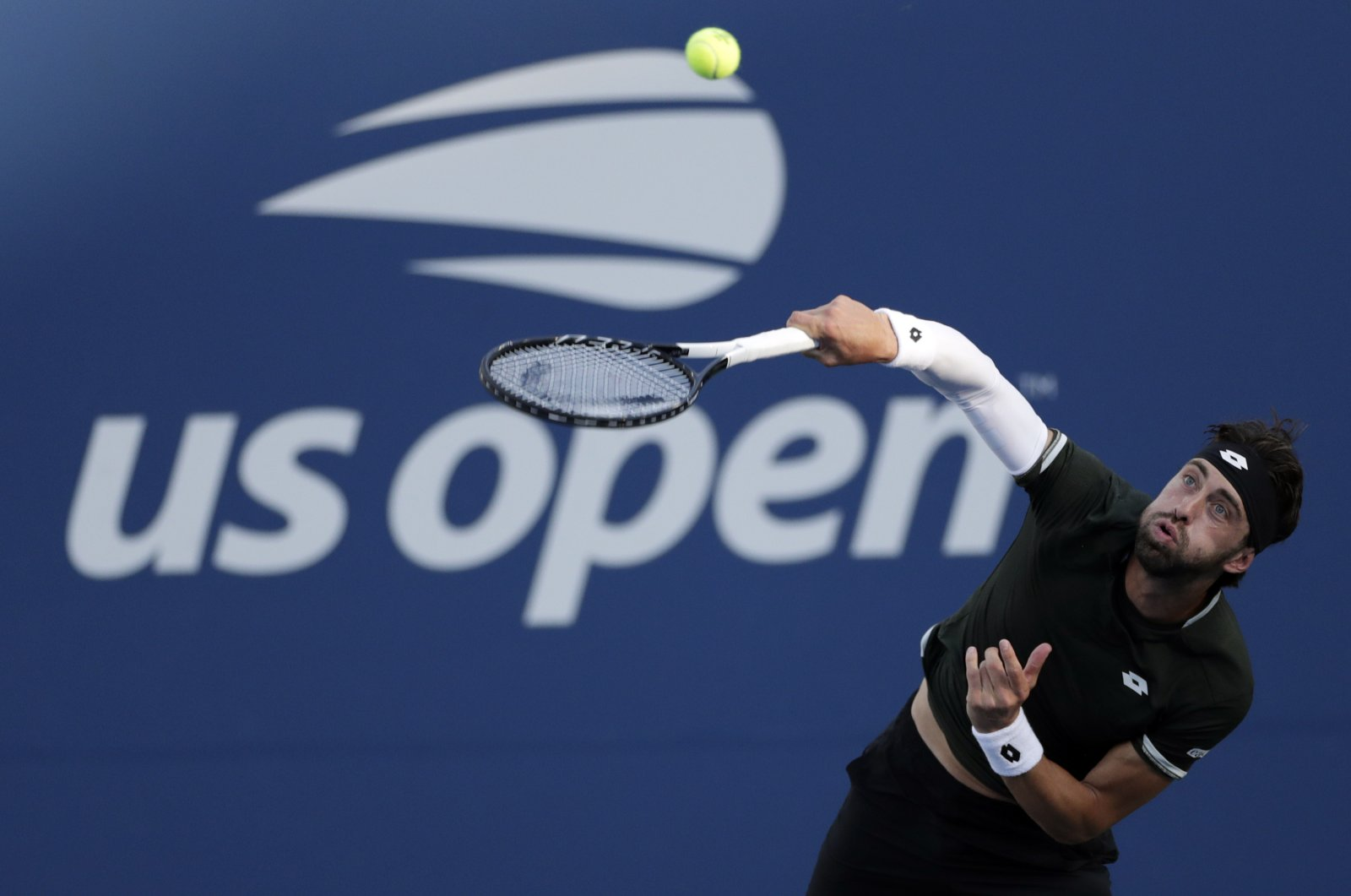Nikoloz Basilashvili serves to Dominik Koepfer during the third round of the U.S. Open in New York, Aug. 30, 2019. (AP Photo)