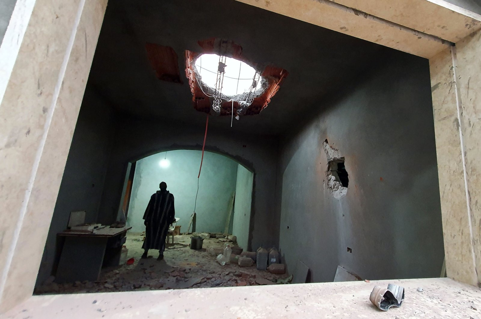 A Libyan man stands at the site of shelling on the residential area of Arada in the capital Tripoli, Tuesdaym April 14, 2020. (AFP)