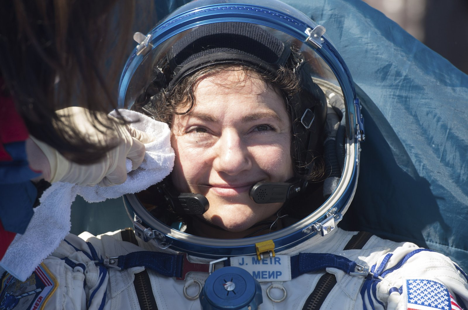 In this handout photo released by Gagarin Cosmonaut Training Centre (GCTC), Roscosmos space agency, U.S. astronaut Jessica Meir gets assistance shortly after the landing of the Russian Soyuz MS-15 space capsule near Kazakh town of Dzhezkazgan, Kazakhstan, Friday, April 17, 2020. (Roscosmos space agency via AP)