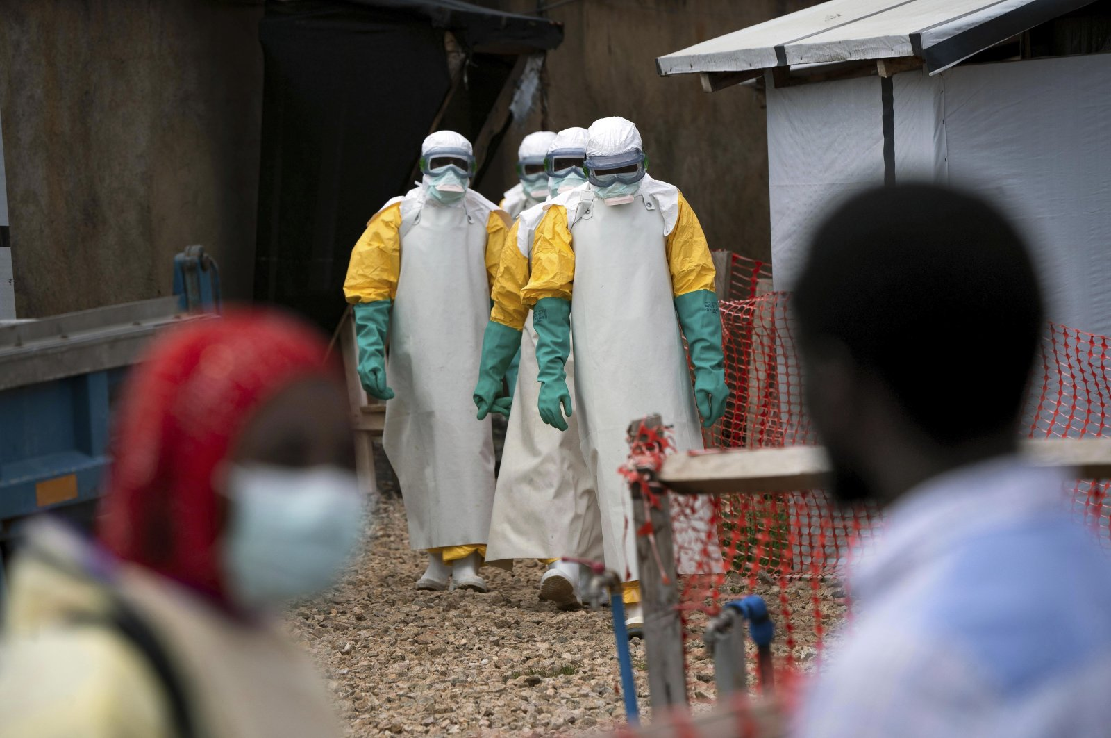 In this Tuesday, July 16, 2019 photo, health workers wearing protective gear begin their shift at an Ebola treatment center in Beni, Congo. (AP Photo)
