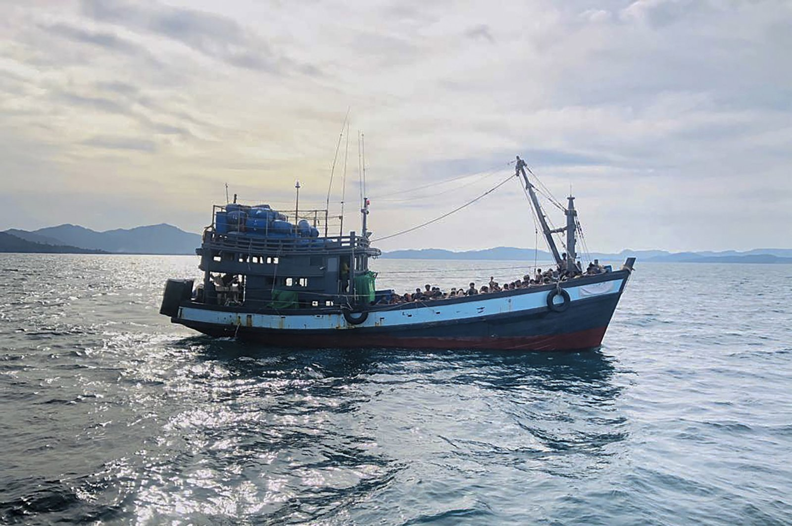 A wooden boat carrying suspected Rohingya migrants are detained in Malaysian territorial waters off the island of Langkawi, in the state of Kedah, Malaysia, April 5, 2020. (EPA Photo)