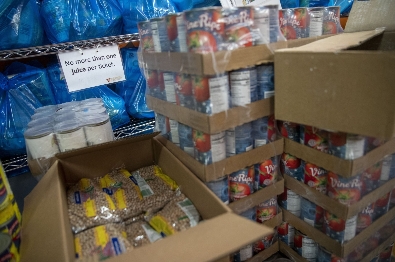 Groceries are stacked in a storage area at The Campaign Against Hunger food pantry, Thursday, April 16, 2020, in the Bedford-Stuyvesant neighborhood of the Brooklyn borough of New York. (AP Photo)
