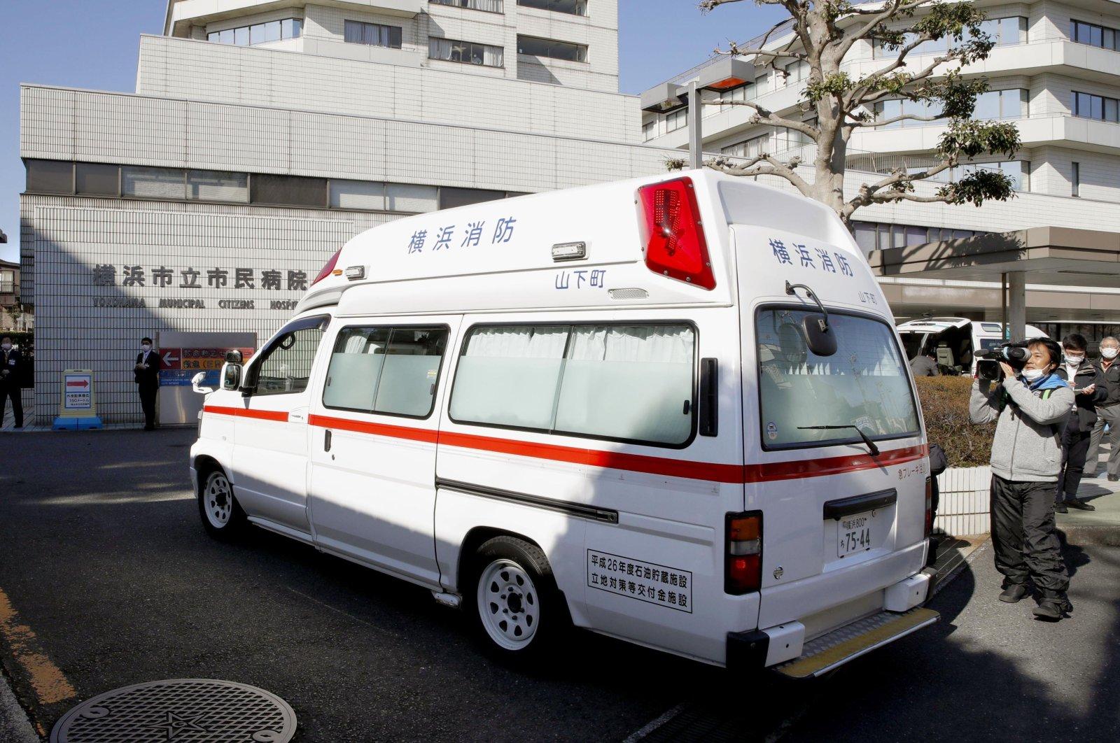 In this Feb. 5, 2020, photo, an ambulance carrying a passenger onboard cruise ship Diamond Princess arrives at a hospital in Yokohama, near Tokyo. (Kyodo News via AP)