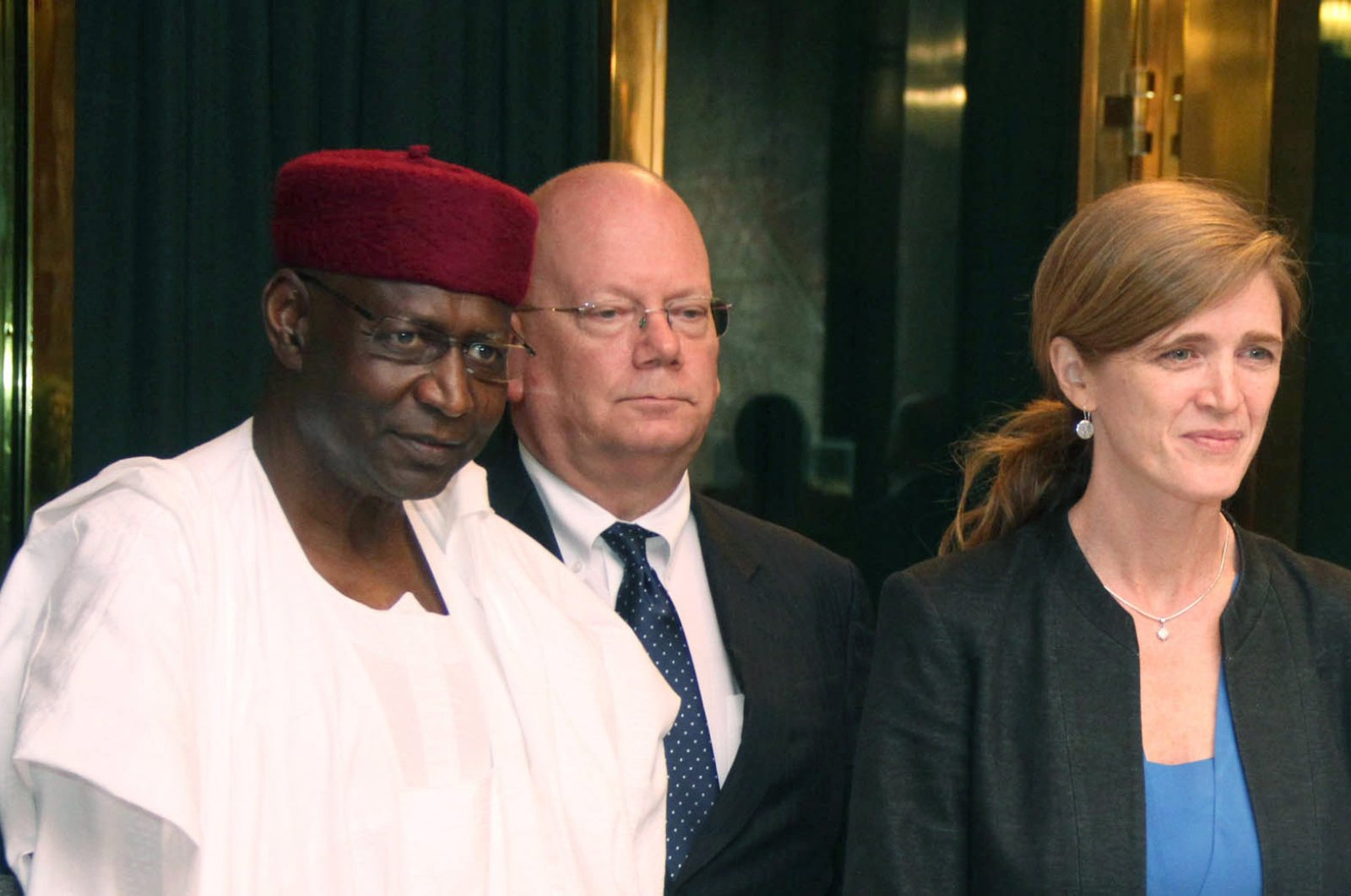 Nigeria's Chief of Staff to the President Abba Kyari (L) stands with US Permanent Representative to the UN Samantha Power (R) and US Ambassador to Nigeria James Entwistle (2nd L) in Abuja, on April 21, 2016. (AFP Photo)