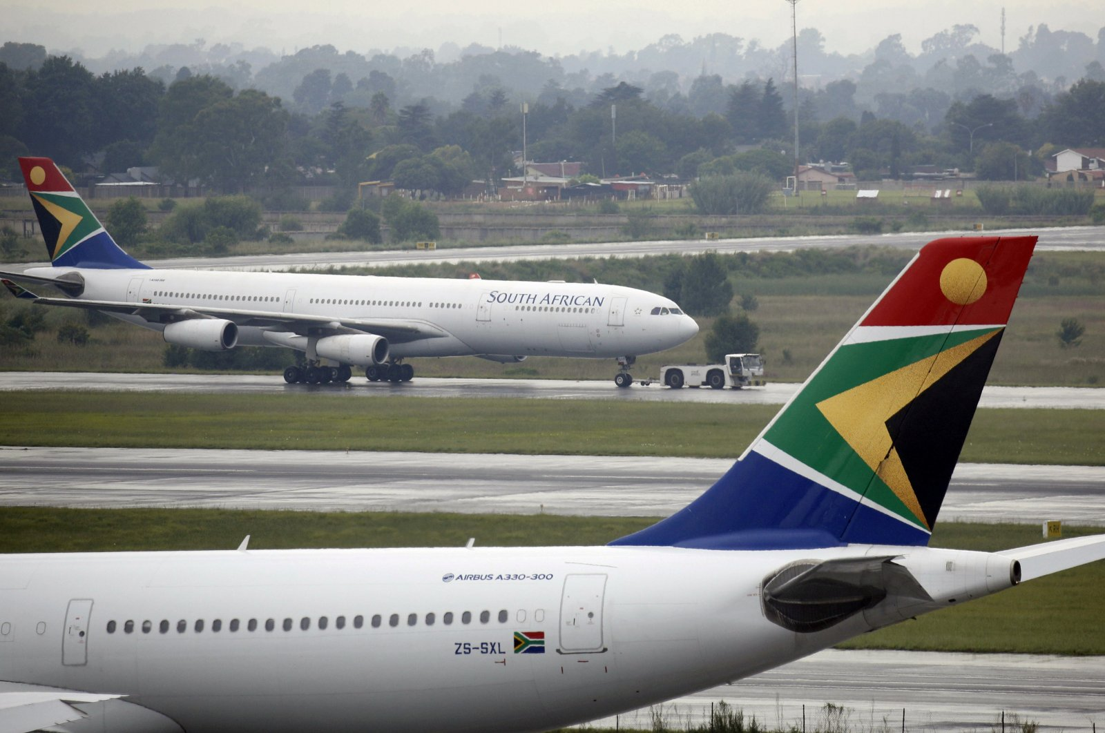 A South African Airways (SAA) plane is towed at O.R. Tambo International Airport in Johannesburg, South Africa, January 18, 2020. (REUTERS Photo)
