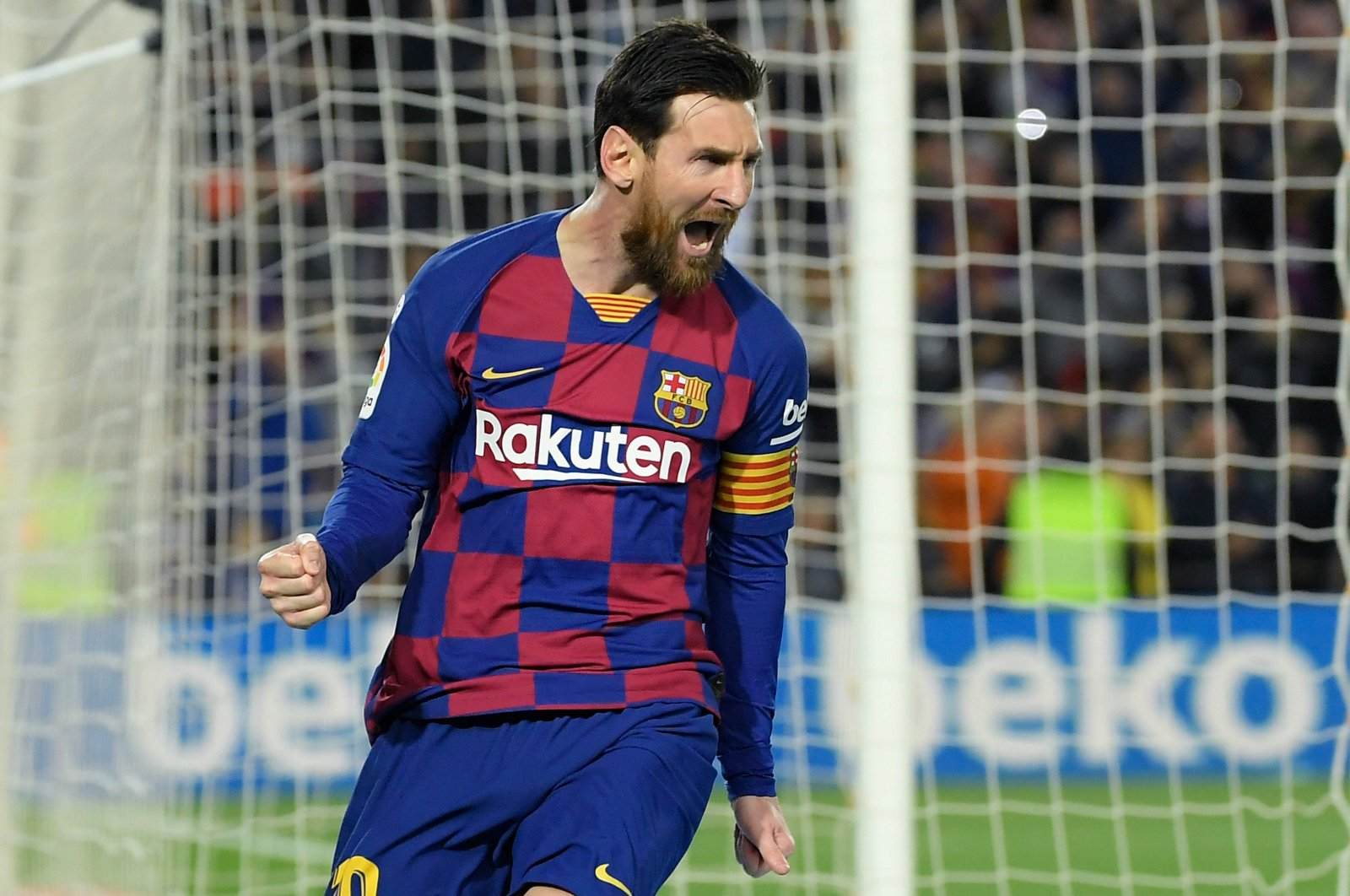 Barcelona's Argentine forward Lionel Messi celebrates after scoring a goal during the Spanish league football match between FC Barcelona and Real Sociedad at the Camp Nou stadium in Barcelona, Spain on March 7, 2020. (AFP Photo)