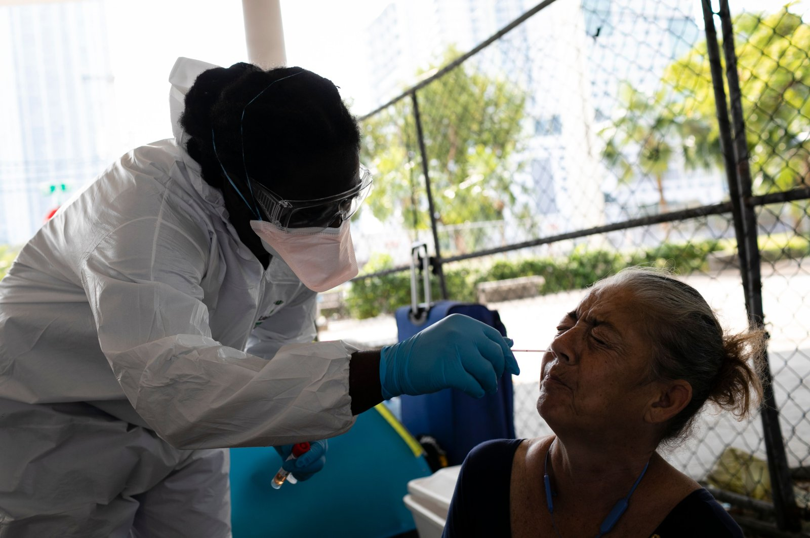 A worker for the Miami-Dade County Homeless Trust takes a sampler test from Elizabeth Sokol, a homeless woman, for coronavirus disease (COVID-19) in downtown Miami, Florida on April 16, 2020. (AFP Photo)