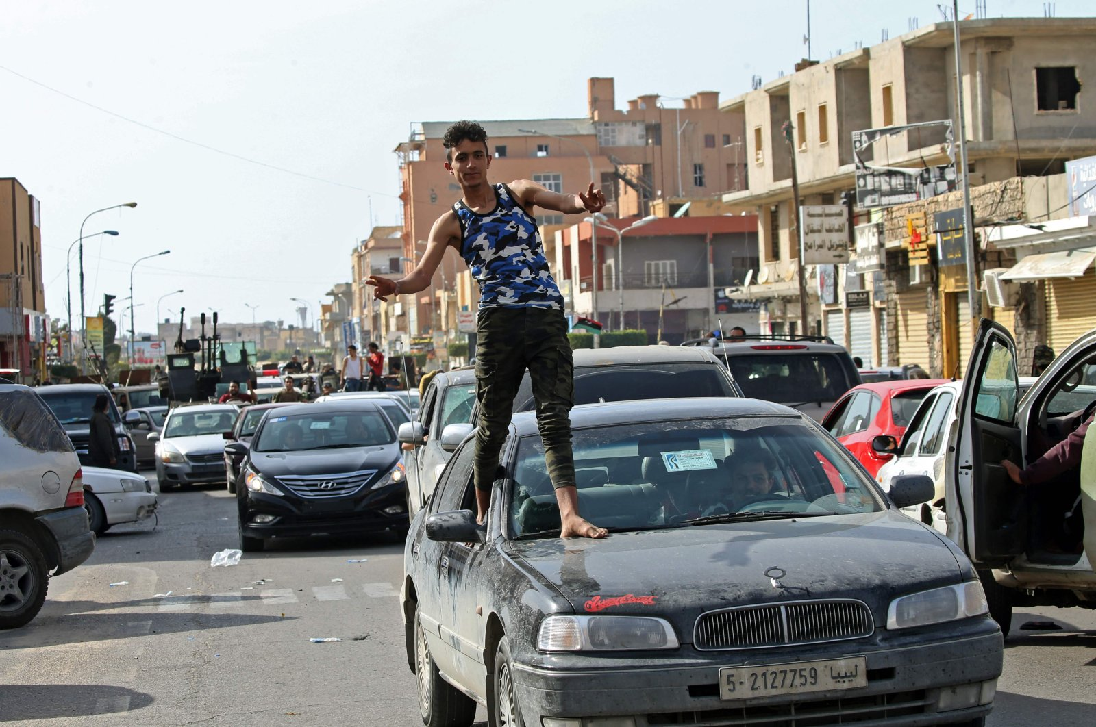 A Libyan man gestures in celebration as fighters loyal to the UN-recognized Government of National Accord (GNA) drove into the coastal city of Sabratha after it seized two coastal cities between Tripoli and the Tunisian border from troops backing Khalifa Haftar, Sabratha, Libya, April 13, 2020. (AFP Photo)