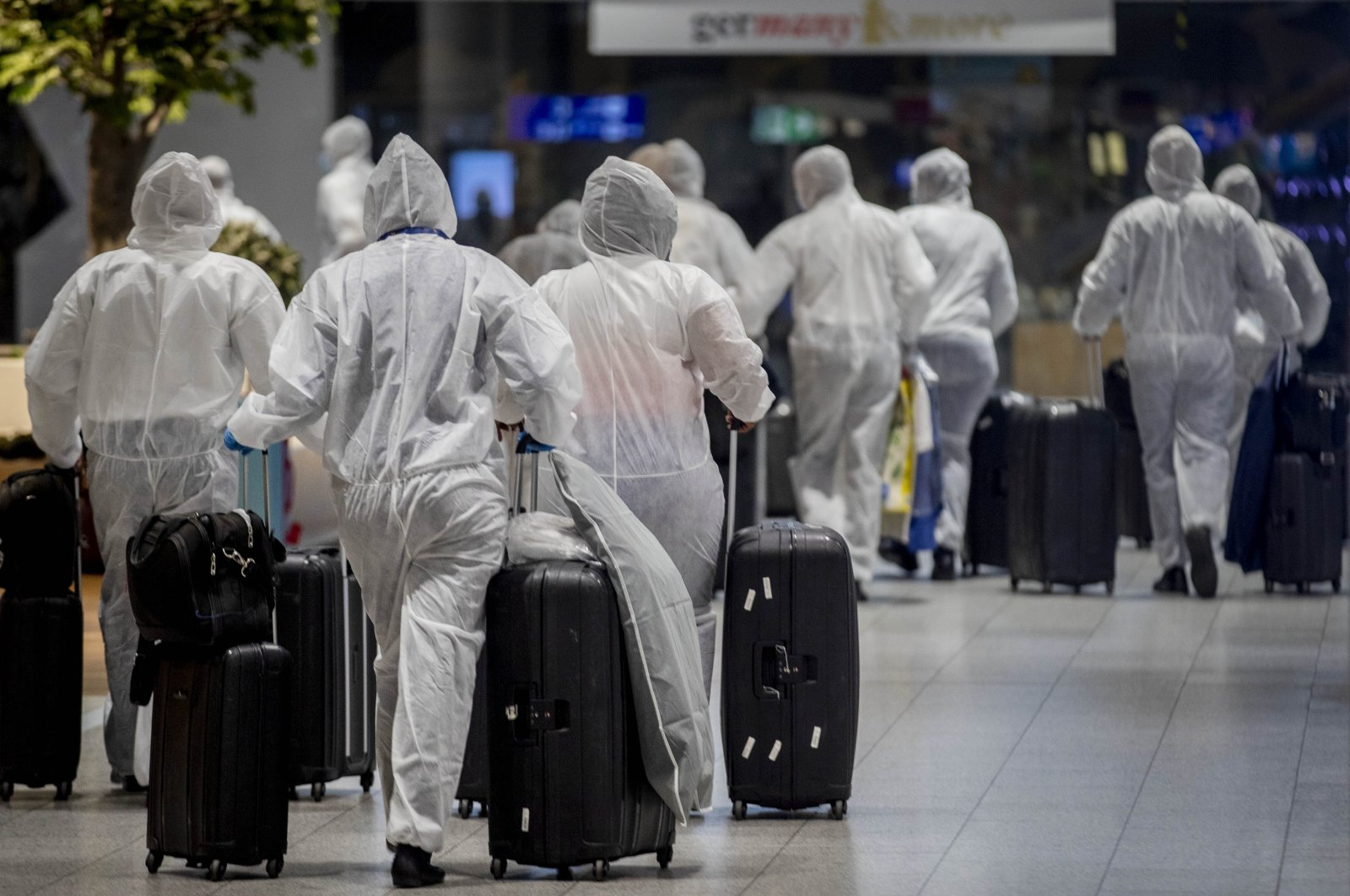 Crew members of South African Airways go through security check-in, Frankfurt, Germany, April 18, 2020. (AP Photo)